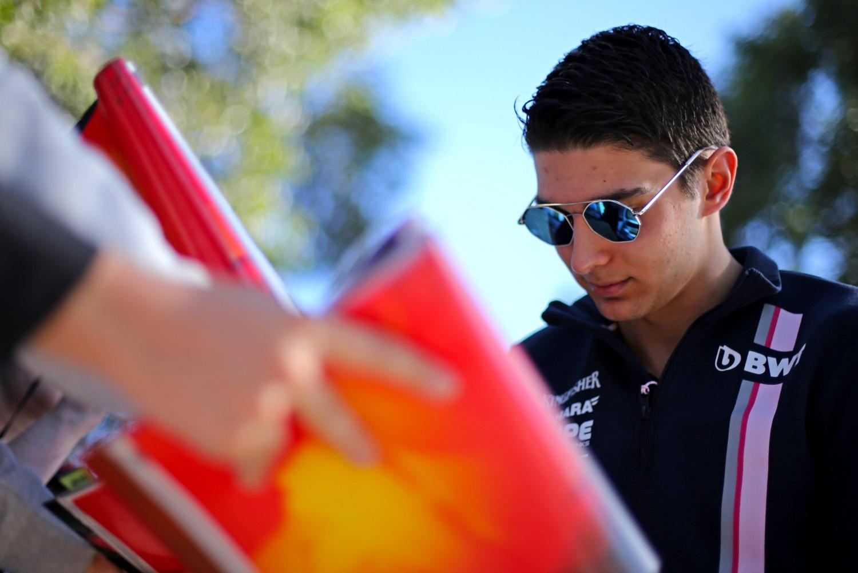 Esteban Ocon (FRA) Sahara Force India F1 Team signs autographs for the fans. Australian Grand Prix, Thursday 22nd March 2018. Albert Park, Melbourne, Australia.