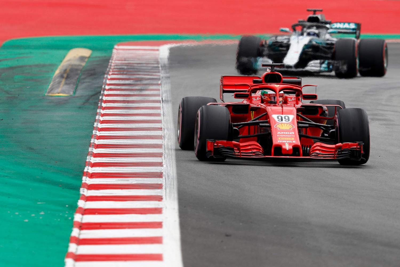 Antonio Giovinazzi, Ferrari SF71H, leads Valtteri Bottas, Mercedes AMG F1 W09.