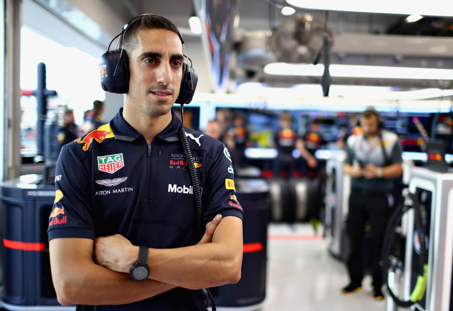 SINGAPORE - SEPTEMBER 14:  Sebastien Buemi of Switzerland and Red Bull Racing looks on in the garage during practice for the Formula One Grand Prix of Singapore at Marina Bay Street Circuit on September 14, 2018 in Singapore.  (Photo by Mark Thompson/Getty Images)