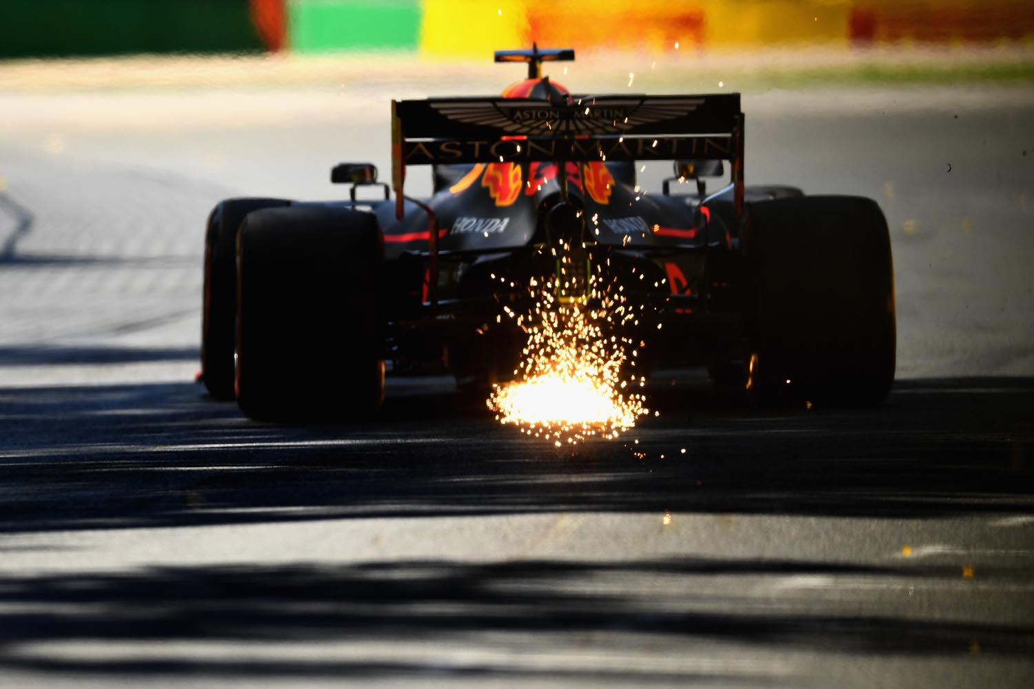 MELBOURNE, AUSTRALIA - MARCH 15: Sparks fly behind Max Verstappen of the Netherlands driving the (33) Aston Martin Red Bull Racing RB15 on track during practice for the F1 Grand Prix of Australia at Melbourne Grand Prix Circuit on March 15, 2019 in Melbourne, Australia.  (Photo by Quinn Rooney/Getty Images) // Getty Images / Red Bull Content Pool  // AP-1YQPD8R8D1W11 // Usage for editorial use only // Please go to www.redbullcontentpool.com for further information. //