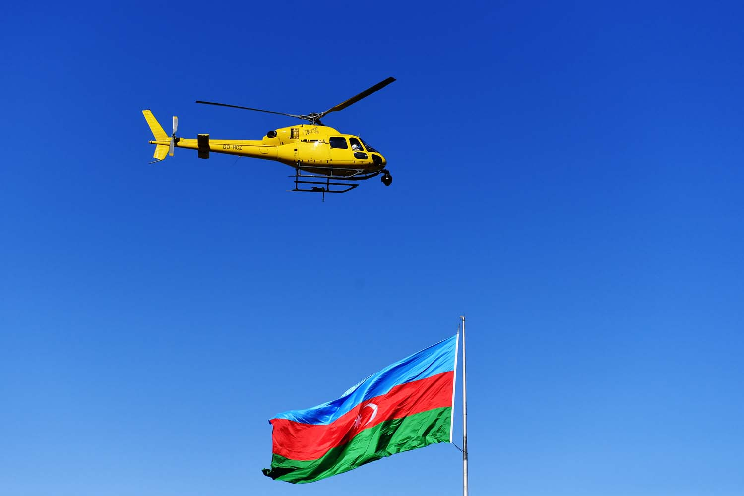 The TV helicopter hovers over the circuit with an Azerbaijan flag