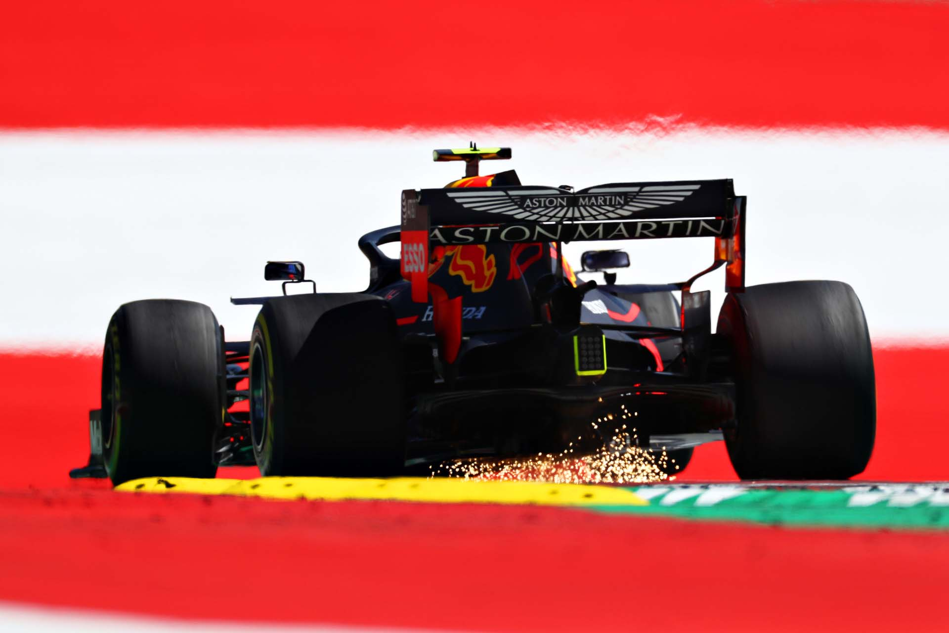 SPIELBERG, AUSTRIA - JUNE 28: Sparks fly behind Pierre Gasly of France driving the (10) Aston Martin Red Bull Racing RB15 during practice for the F1 Grand Prix of Austria at Red Bull Ring on June 28, 2019 in Spielberg, Austria. (Photo by Mark Thompson/Getty Images) // Getty Images / Red Bull Content Pool  // AP-1ZSNNKF612111 // Usage for editorial use only // Please go to www.redbullcontentpool.com for further information. //