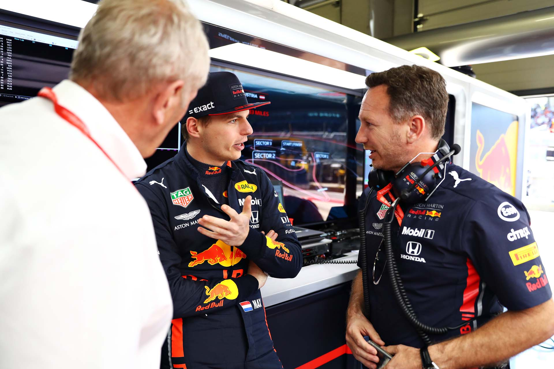 SPIELBERG, AUSTRIA - JUNE 29: Max Verstappen of Netherlands and Red Bull Racing talks with Red Bull Racing Team Principal Christian Horner and Red Bull Racing Team Consultant Dr Helmut Marko in the garage during qualifying for the F1 Grand Prix of Austria at Red Bull Ring on June 29, 2019 in Spielberg, Austria. (Photo by Mark Thompson/Getty Images) // Getty Images / Red Bull Content Pool  // AP-1ZSYN5YDS1W11 // Usage for editorial use only // Please go to www.redbullcontentpool.com for further information. //