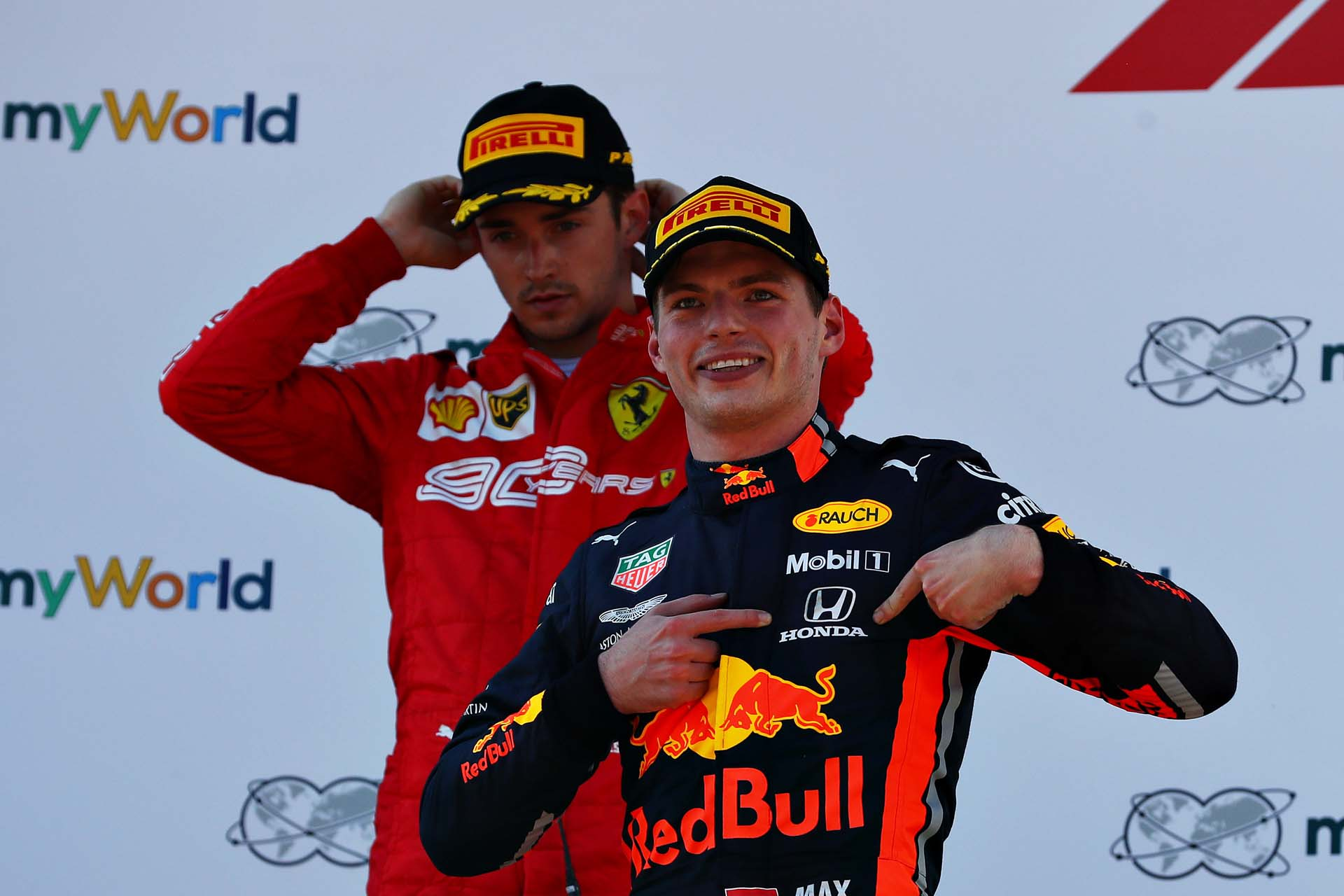 SPIELBERG, AUSTRIA - JUNE 30: Race winner Max Verstappen of Netherlands and Red Bull Racing celebrates on the podium as second placed Charles Leclerc of Monaco and Ferrari looks dejected during the F1 Grand Prix of Austria at Red Bull Ring on June 30, 2019 in Spielberg, Austria. (Photo by Mark Thompson/Getty Images) // Getty Images / Red Bull Content Pool  // AP-1ZTAAMPDW2111 // Usage for editorial use only // Please go to www.redbullcontentpool.com for further information. //
