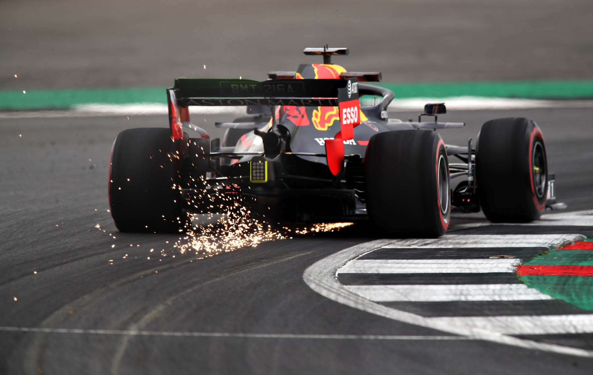 NORTHAMPTON, ENGLAND - JULY 12: Sparks fly behind Max Verstappen of the Netherlands driving the (33) Aston Martin Red Bull Racing RB15 on track during practice for the F1 Grand Prix of Great Britain at Silverstone on July 12, 2019 in Northampton, England. (Photo by Bryn Lennon/Getty Images) // Getty Images / Red Bull Content Pool  // AP-1ZX37MVE51W11 // Usage for editorial use only // Please go to www.redbullcontentpool.com for further information. //