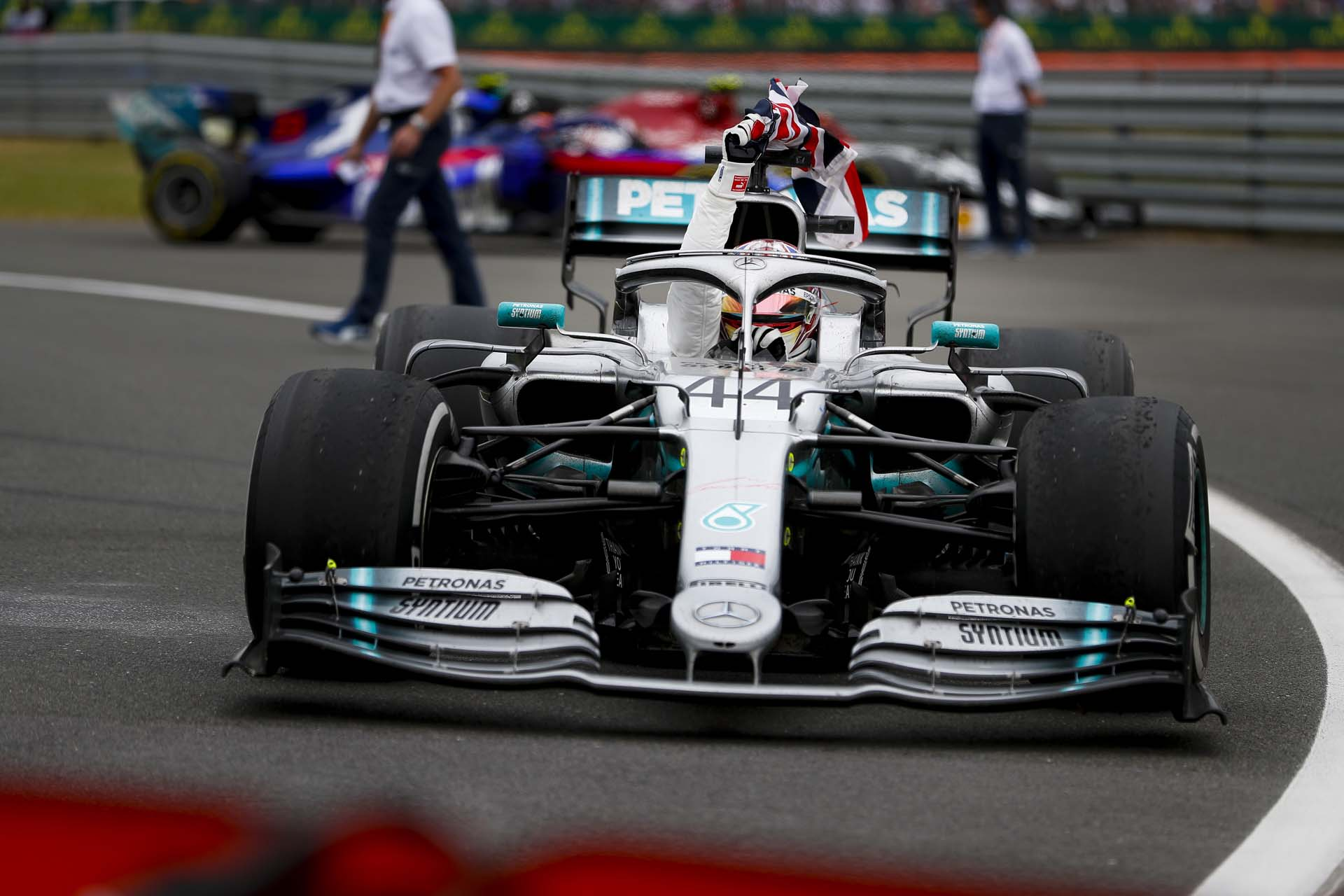 SILVERSTONE, UNITED KINGDOM - JULY 14: Race winner Lewis Hamilton, Mercedes AMG F1 W10 with a flag during the British GP at Silverstone on July 14, 2019 in Silverstone, United Kingdom. (Photo by Glenn Dunbar / LAT Images)