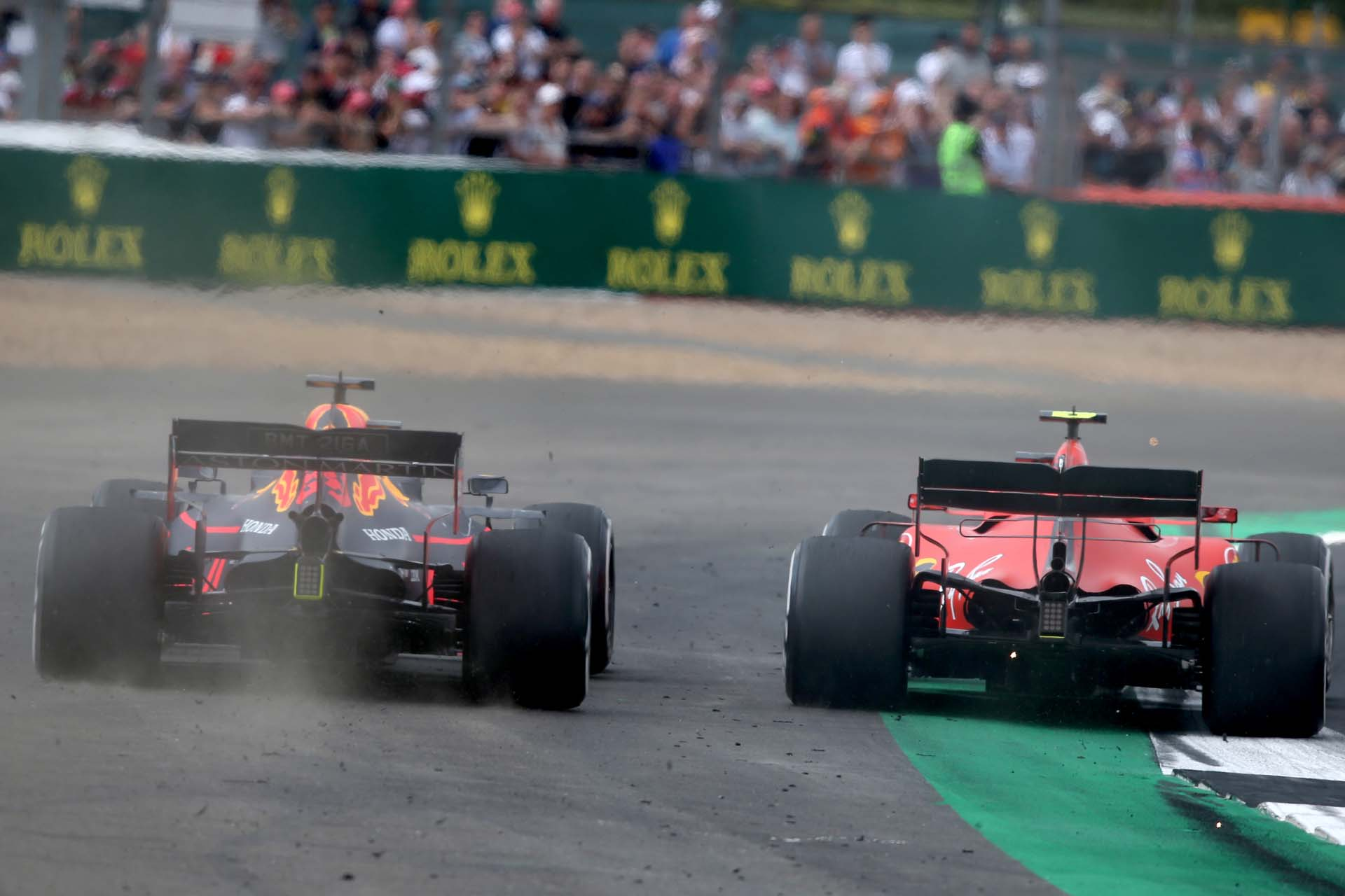 NORTHAMPTON, ENGLAND - JULY 14: Max Verstappen of the Netherlands driving the (33) Aston Martin Red Bull Racing RB15 runs wide as he battles for track position with Charles Leclerc of Monaco driving the (16) Scuderia Ferrari SF90 during the F1 Grand Prix of Great Britain at Silverstone on July 14, 2019 in Northampton, England. (Photo by Charles Coates/Getty Images) // Getty Images / Red Bull Content Pool  // AP-1ZXUVU8QN2111 // Usage for editorial use only // Please go to www.redbullcontentpool.com for further information. //