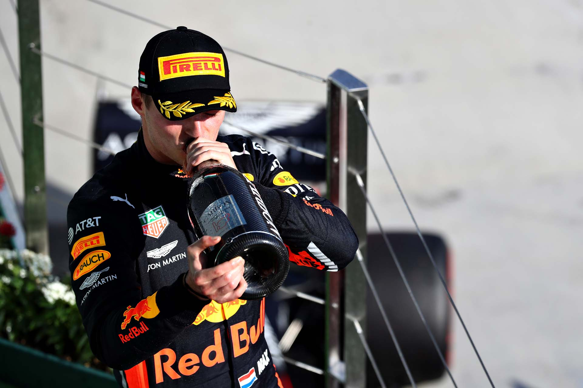 BUDAPEST, HUNGARY - AUGUST 04: Second placed Max Verstappen of Netherlands and Red Bull Racing celebrates on the podium during the F1 Grand Prix of Hungary at Hungaroring on August 04, 2019 in Budapest, Hungary. (Photo by Mark Thompson/Getty Images) // Getty Images / Red Bull Content Pool  // AP-215JMRMTW1W11 // Usage for editorial use only // Please go to www.redbullcontentpool.com for further information. //