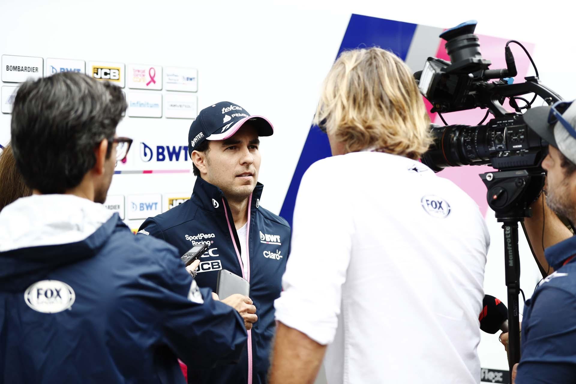 Sergio Perez, Racing Point, talks to the media
