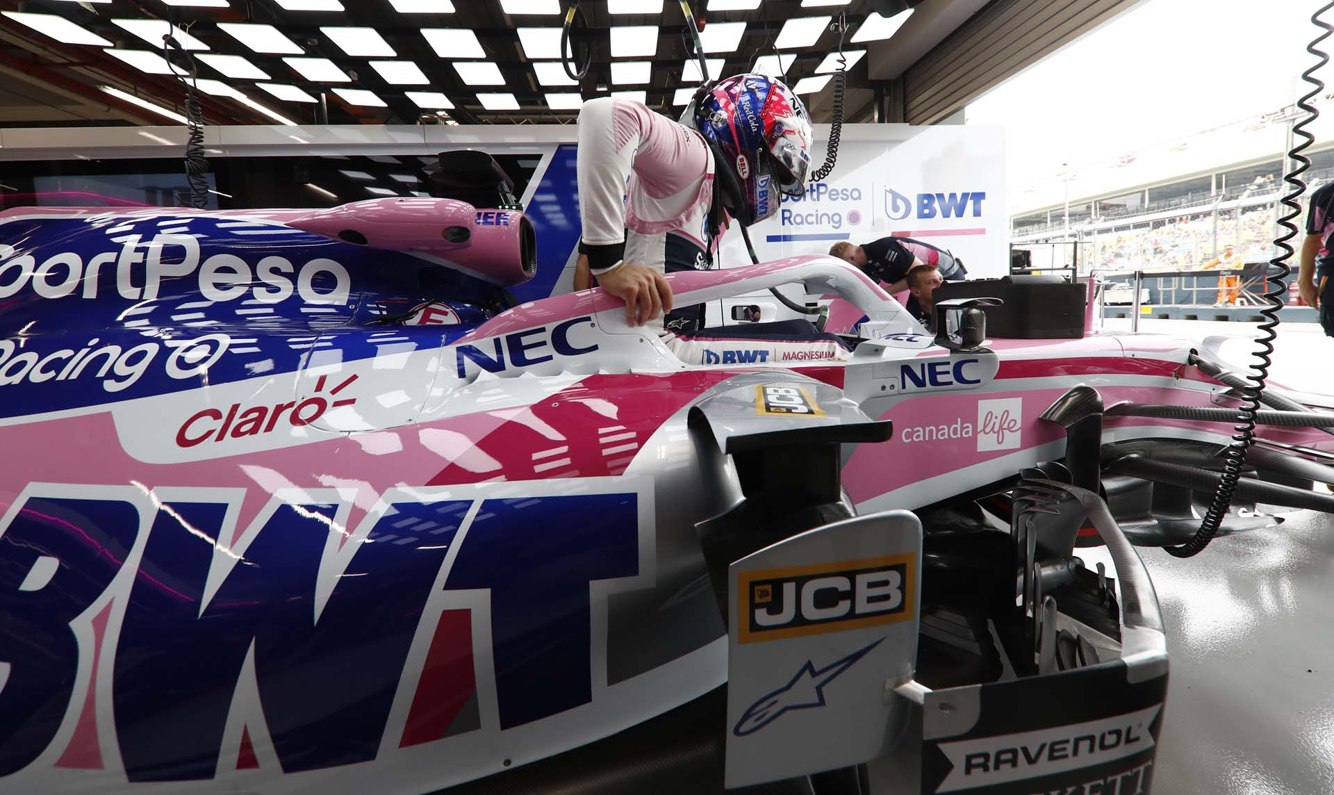 Sergio Perez, Racing Point RP19 gets into his car before FP1