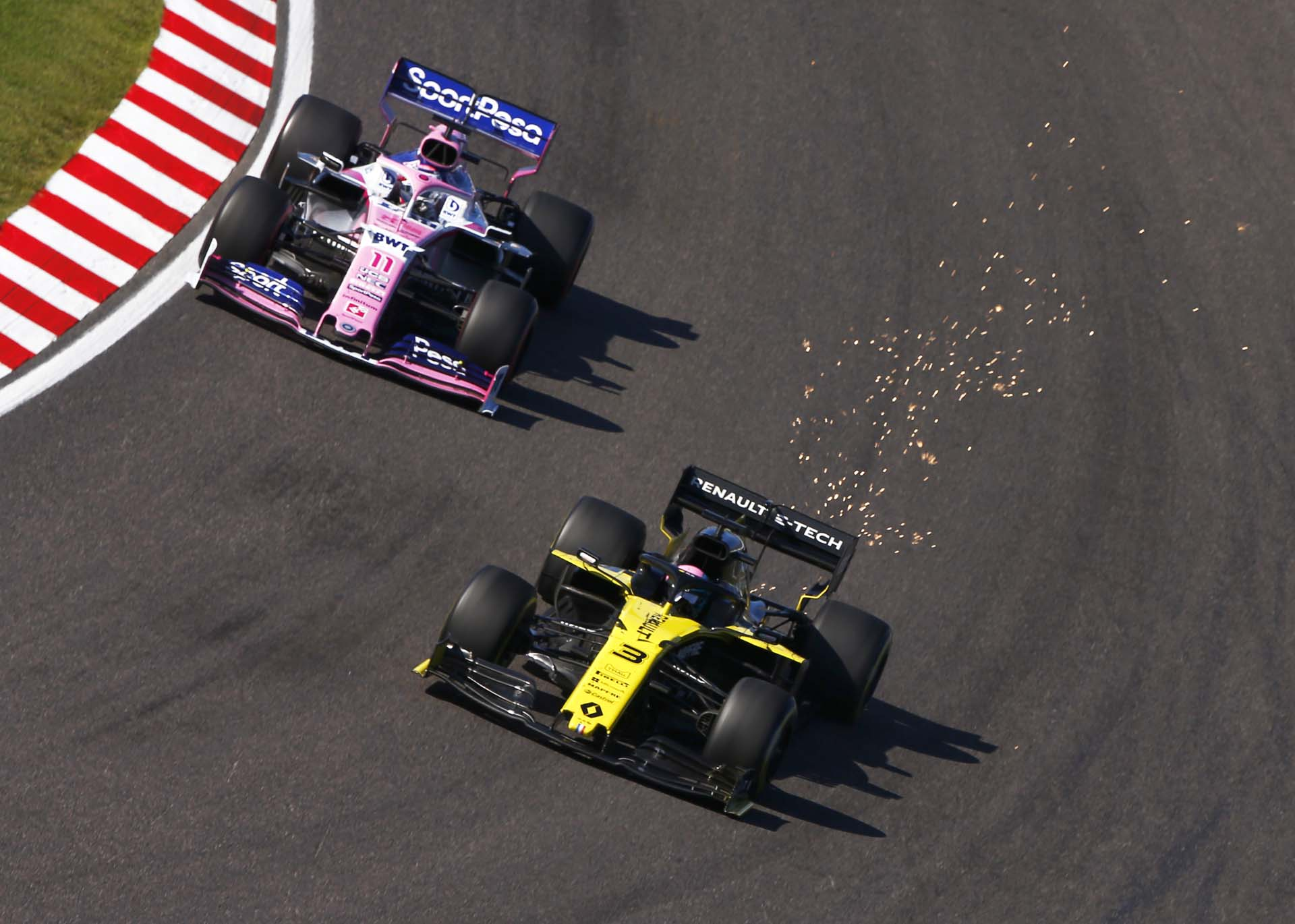 Daniel Ricciardo, Renault R.S.19 and Sergio Perez, Racing Point RP19