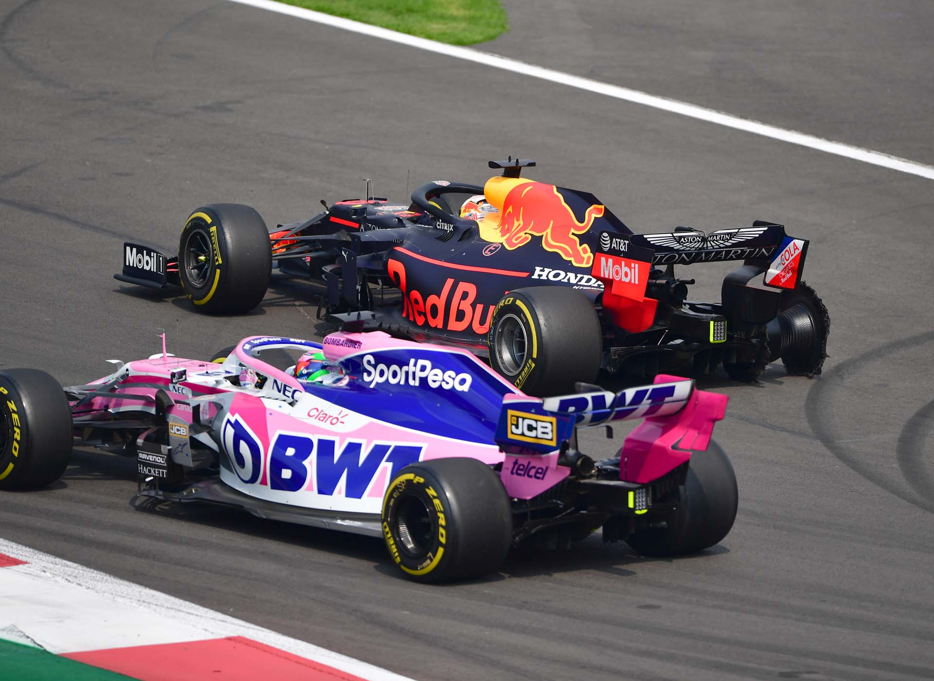 Sergio Perez, Racing Point RP19 and Max Verstappen, Red Bull Racing RB15