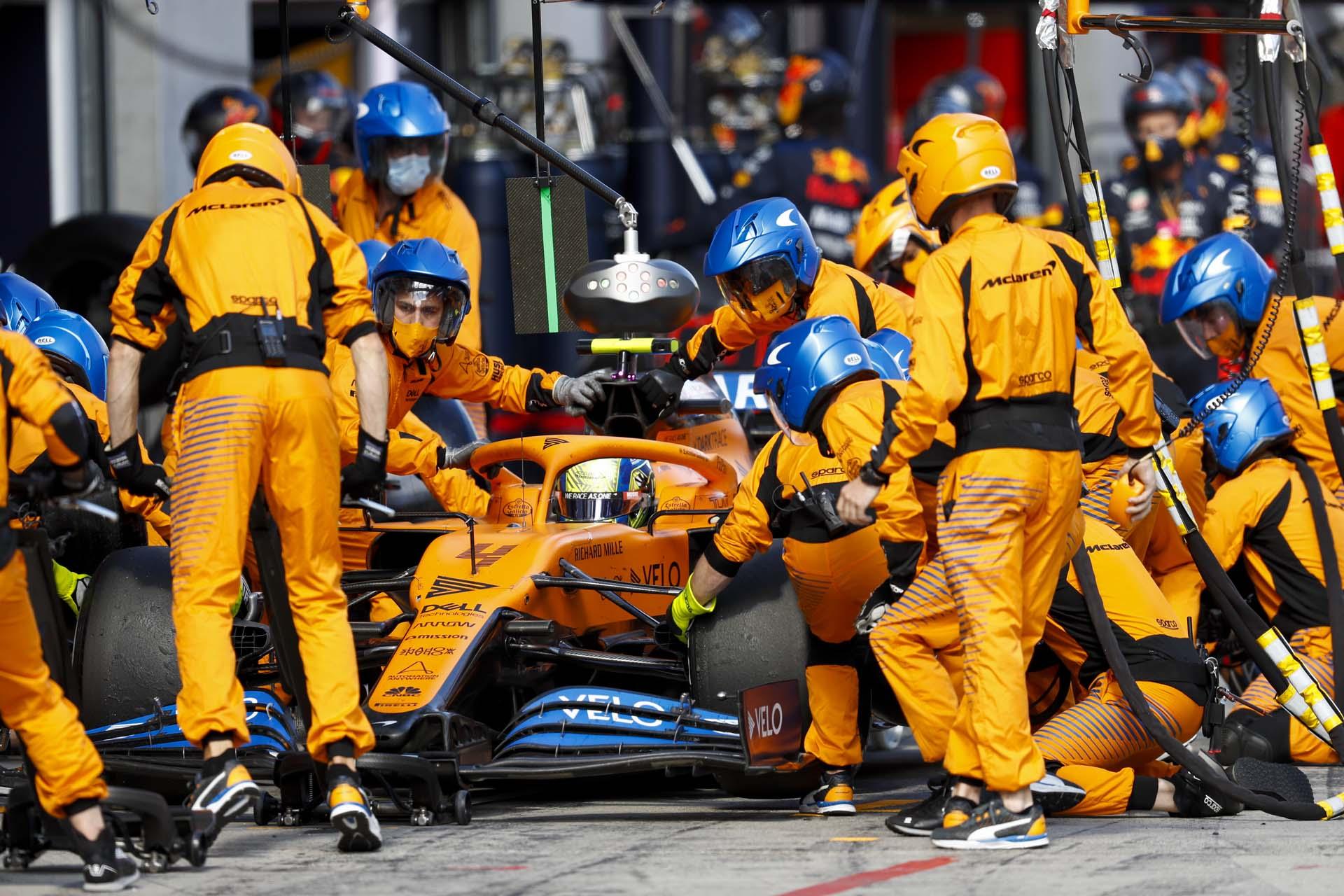 Lando Norris, McLaren MCL35, makes a pit stop