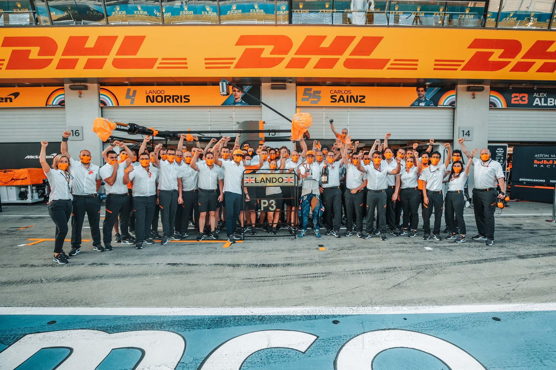 Lando Norris, McLaren, celebrates with the team after scoring his maiden podium