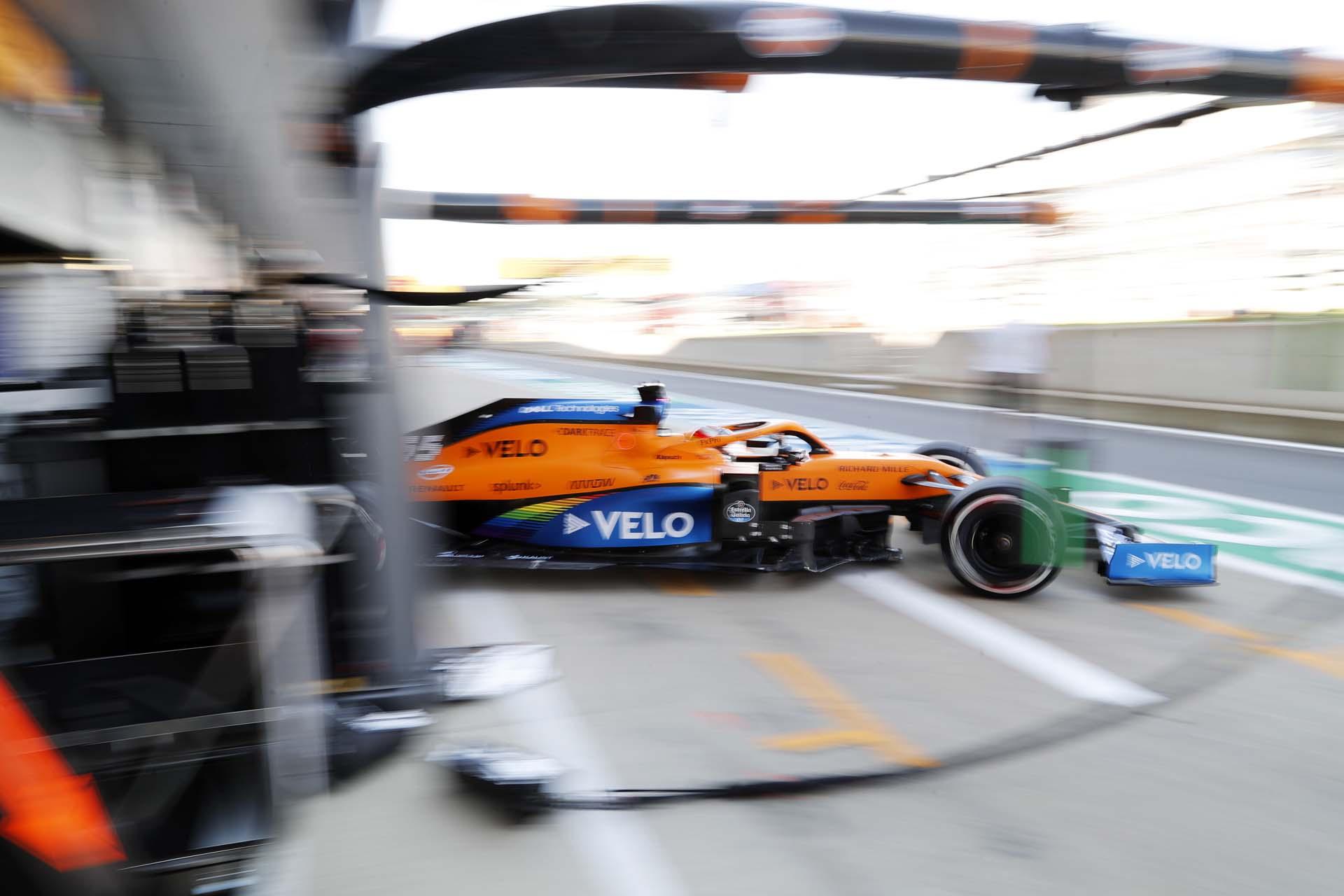 Carlos Sainz, McLaren MCL35, leaves the garage