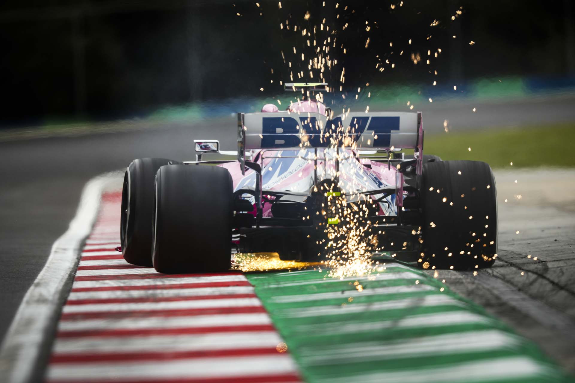 Sparks fly from the rear of Lance Stroll, Racing Point RP20