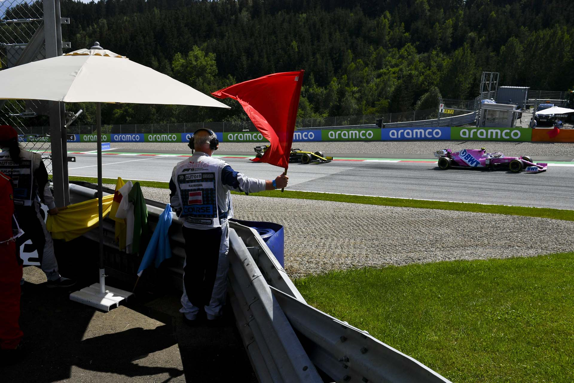 Marshal waves red flag as Lance Stroll, Racing Point RP20 passes by