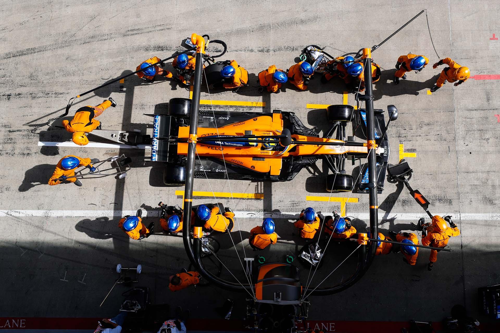 Lando Norris, McLaren MCL35, makes a stop