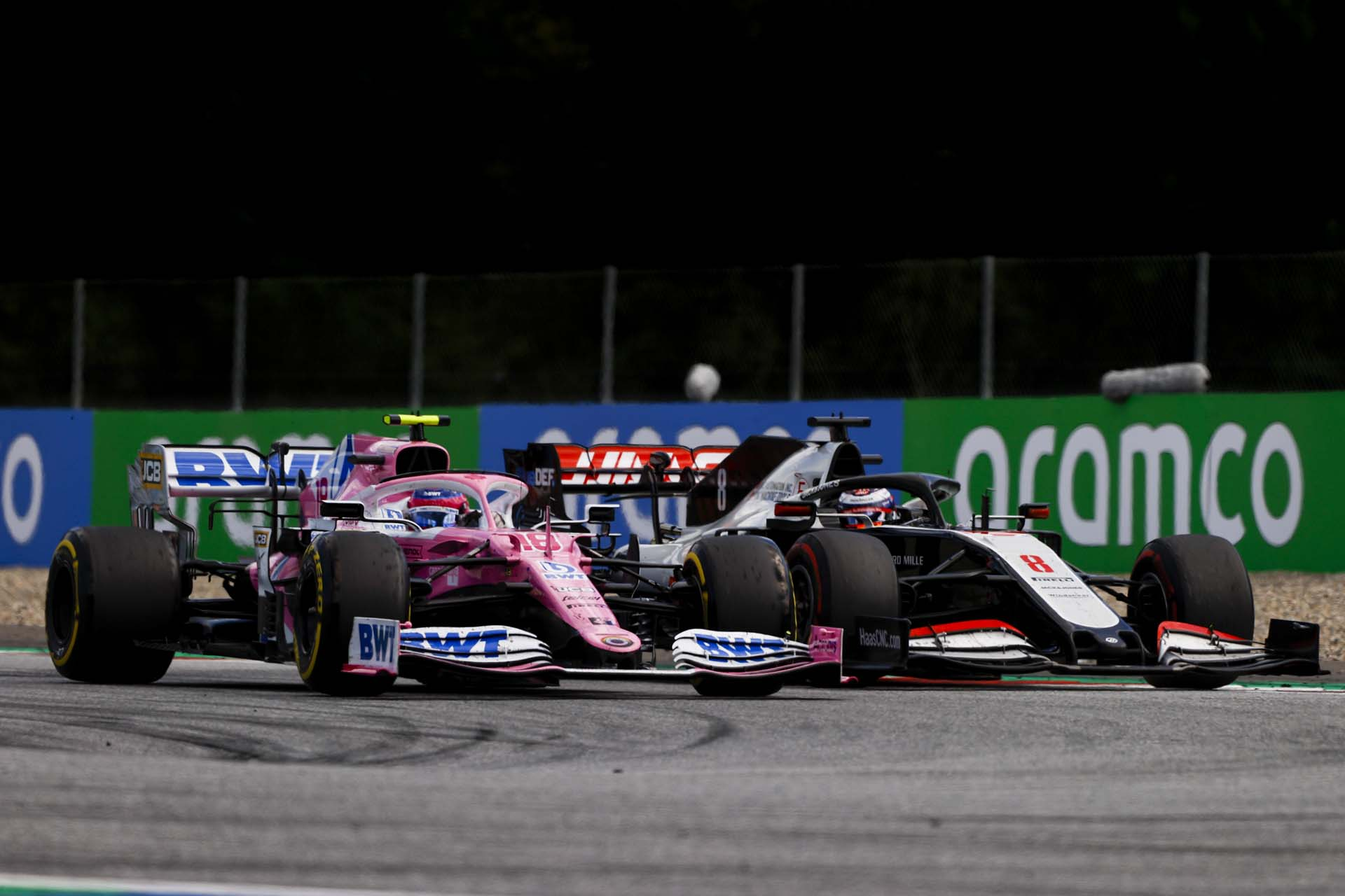 Lance Stroll, Racing Point RP20 and Romain Grosjean, Haas VF-20 battle