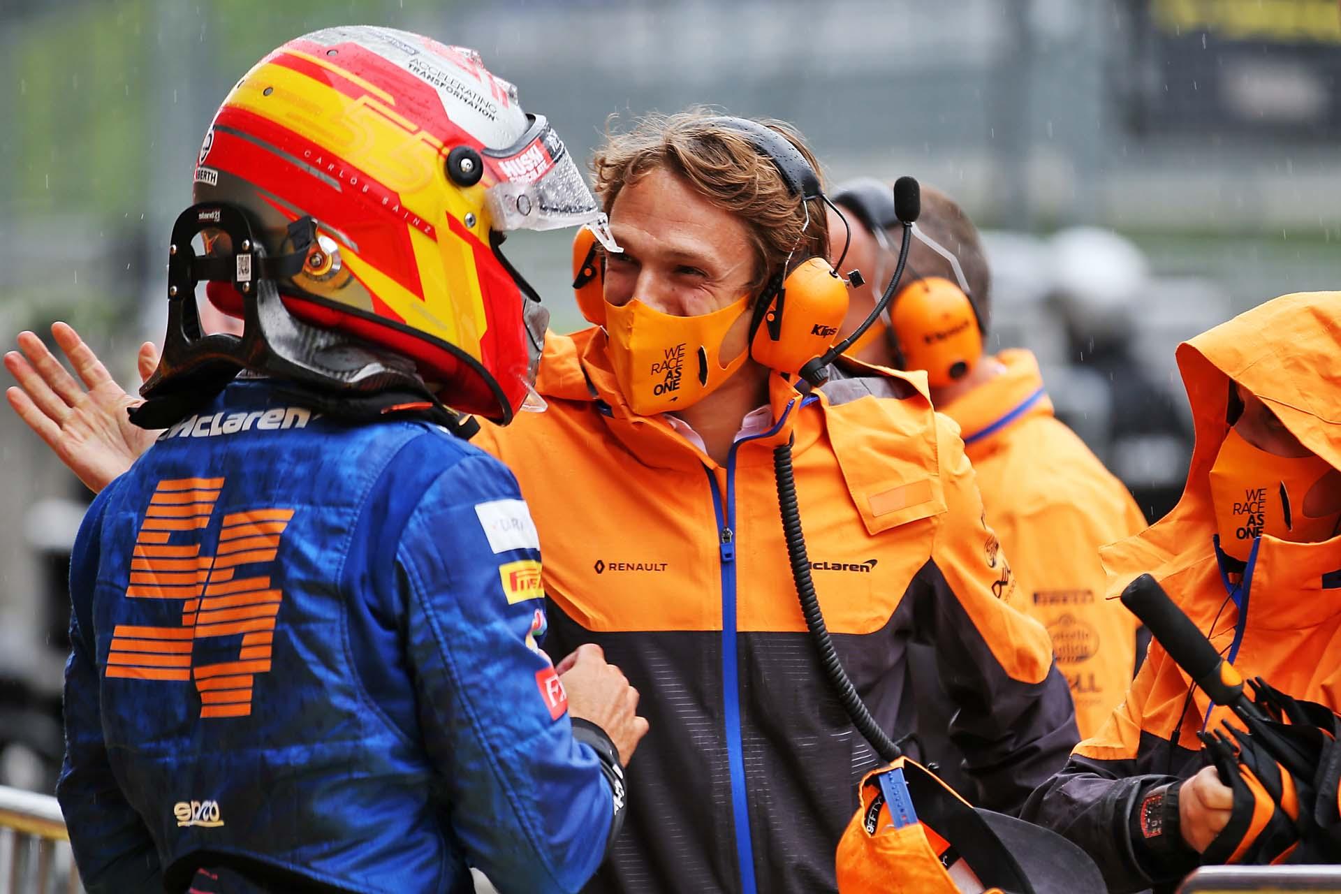 Carlos Sainz, McLaren, is congratulated after qualifying