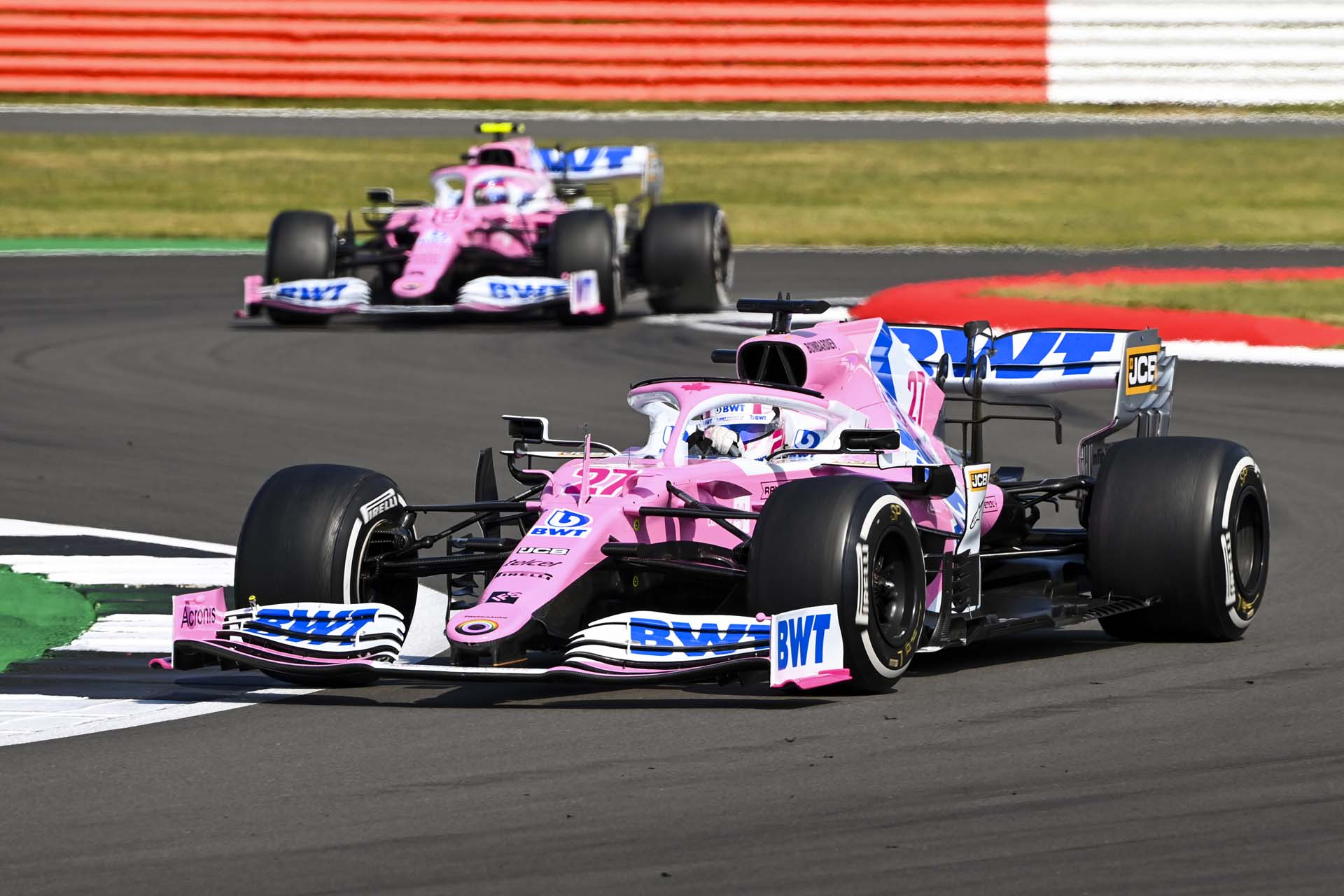 Nico Hulkenberg, Racing Point RP20, leads Lance Stroll, Racing Point RP20