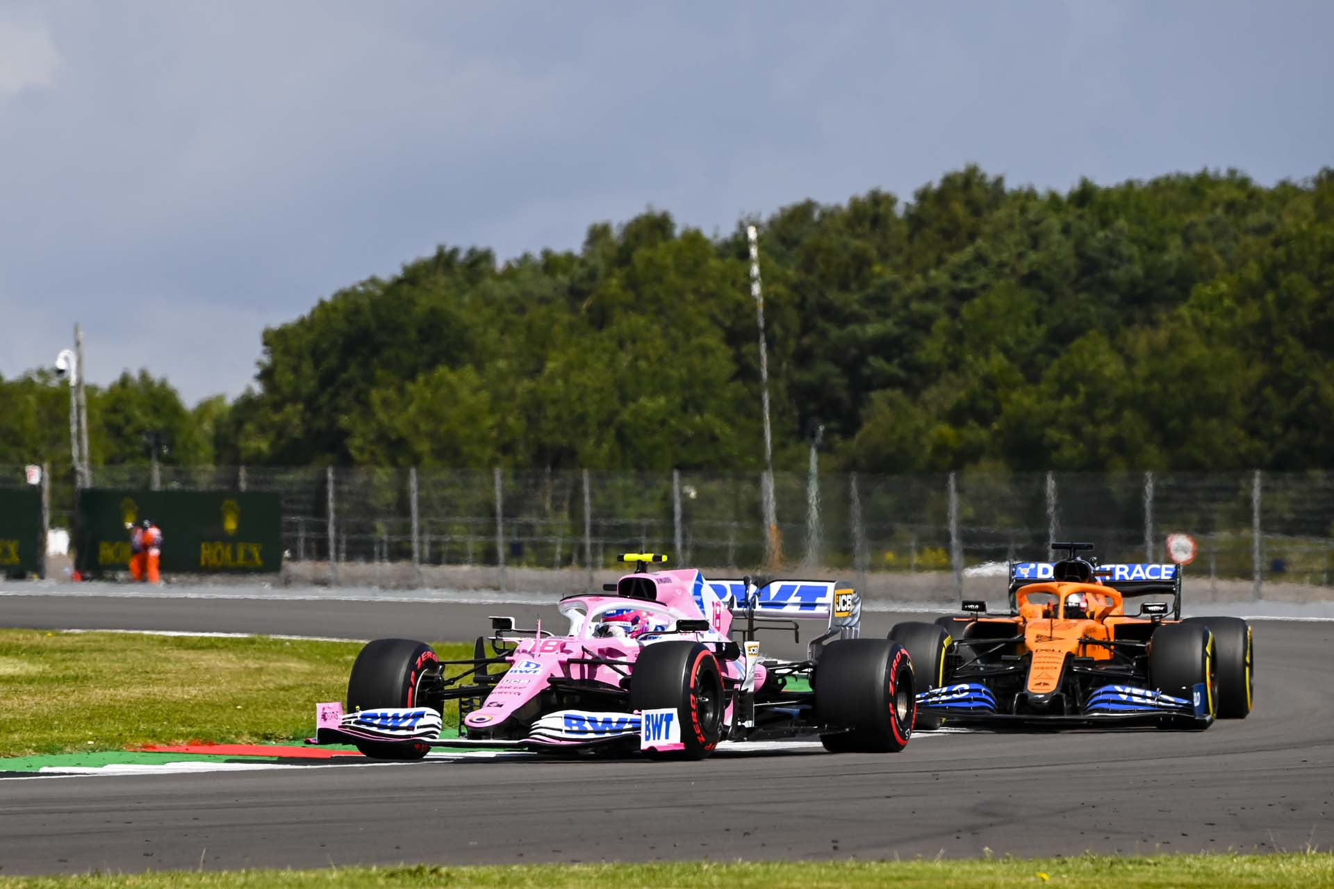 Lance Stroll, Racing Point RP20, leads Carlos Sainz, McLaren MCL35
