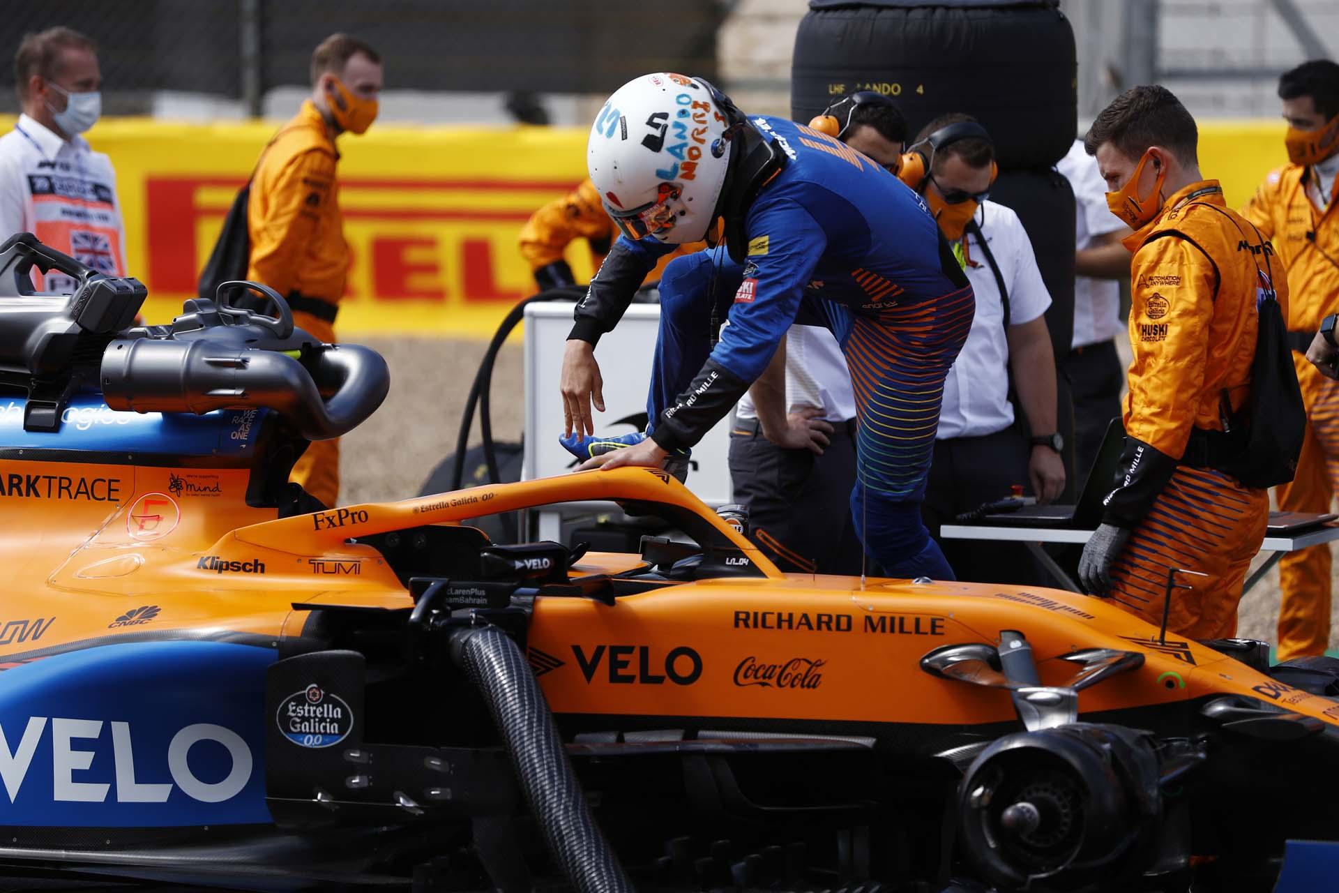 Lando Norris, McLaren, enters his car on the grid