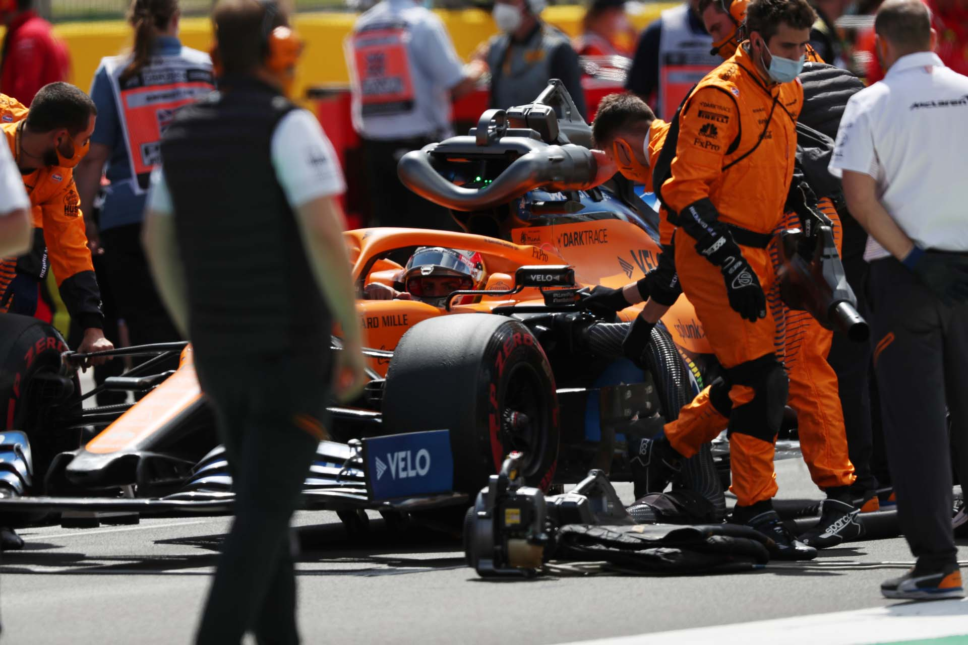 Carlos Sainz, McLaren MCL35, on the grid with his mechanics