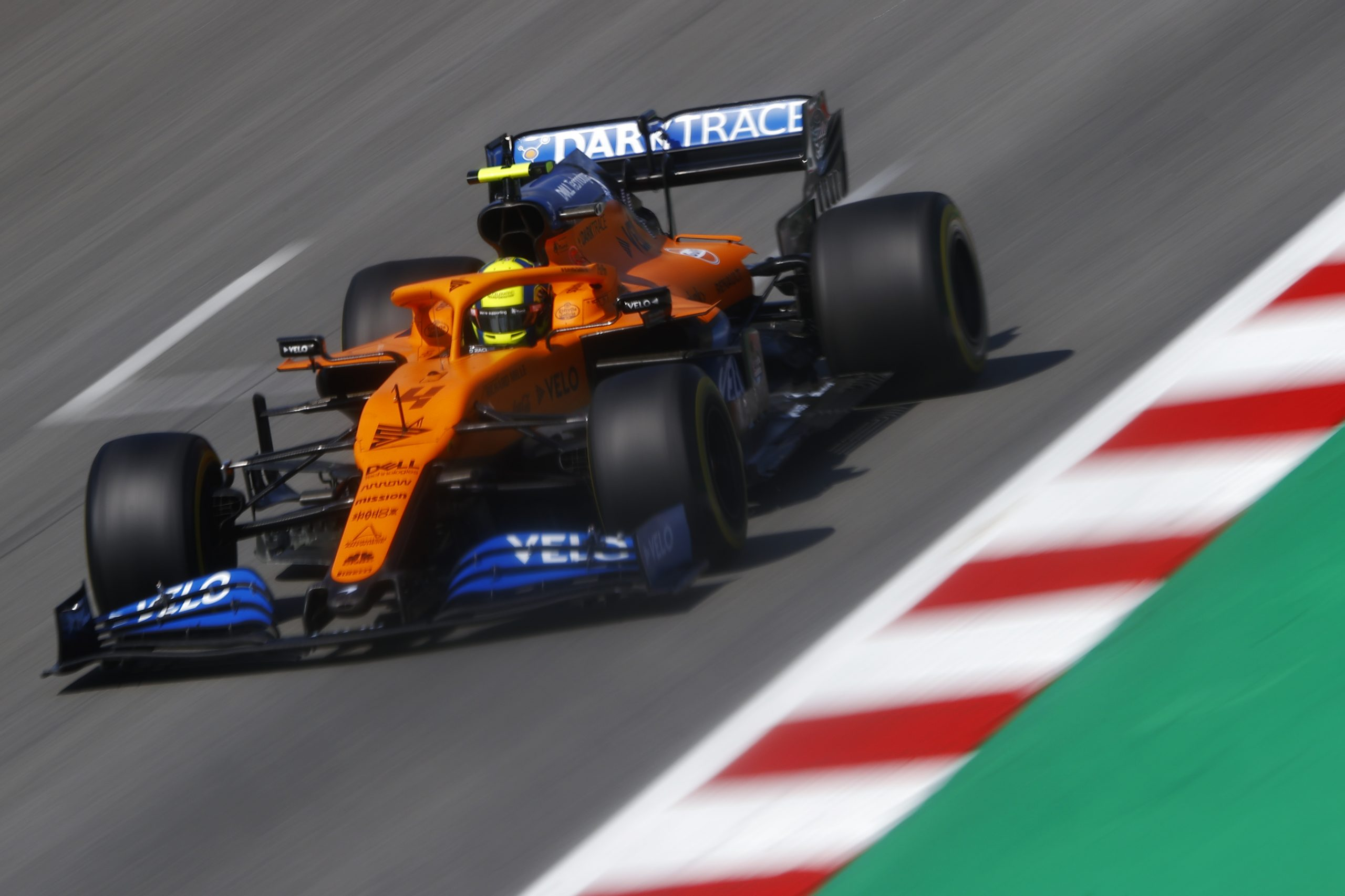 Lando Norris, McLaren MCL35, on the pit straight