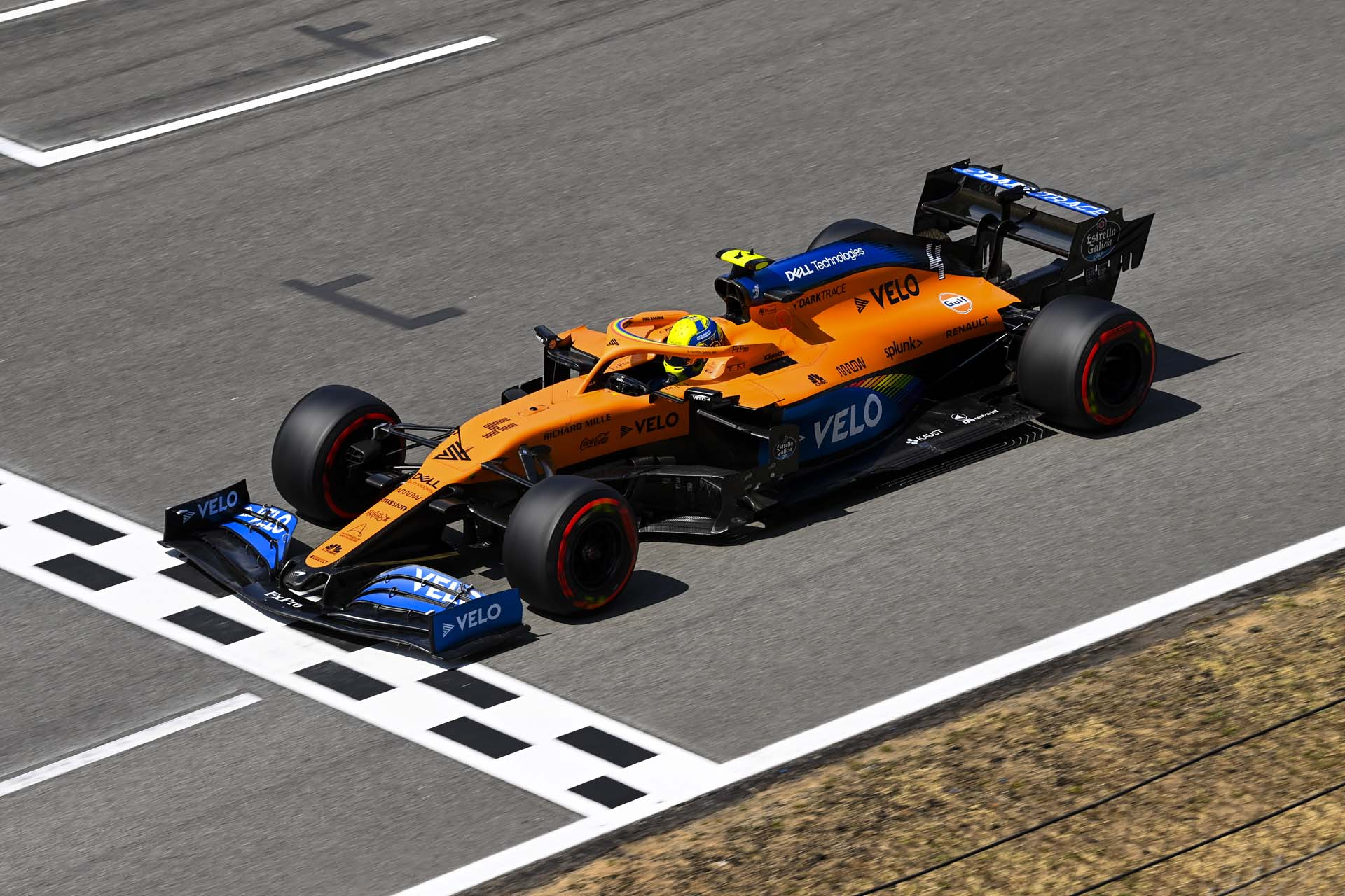 Lando Norris, McLaren MCL35, on the pit straight