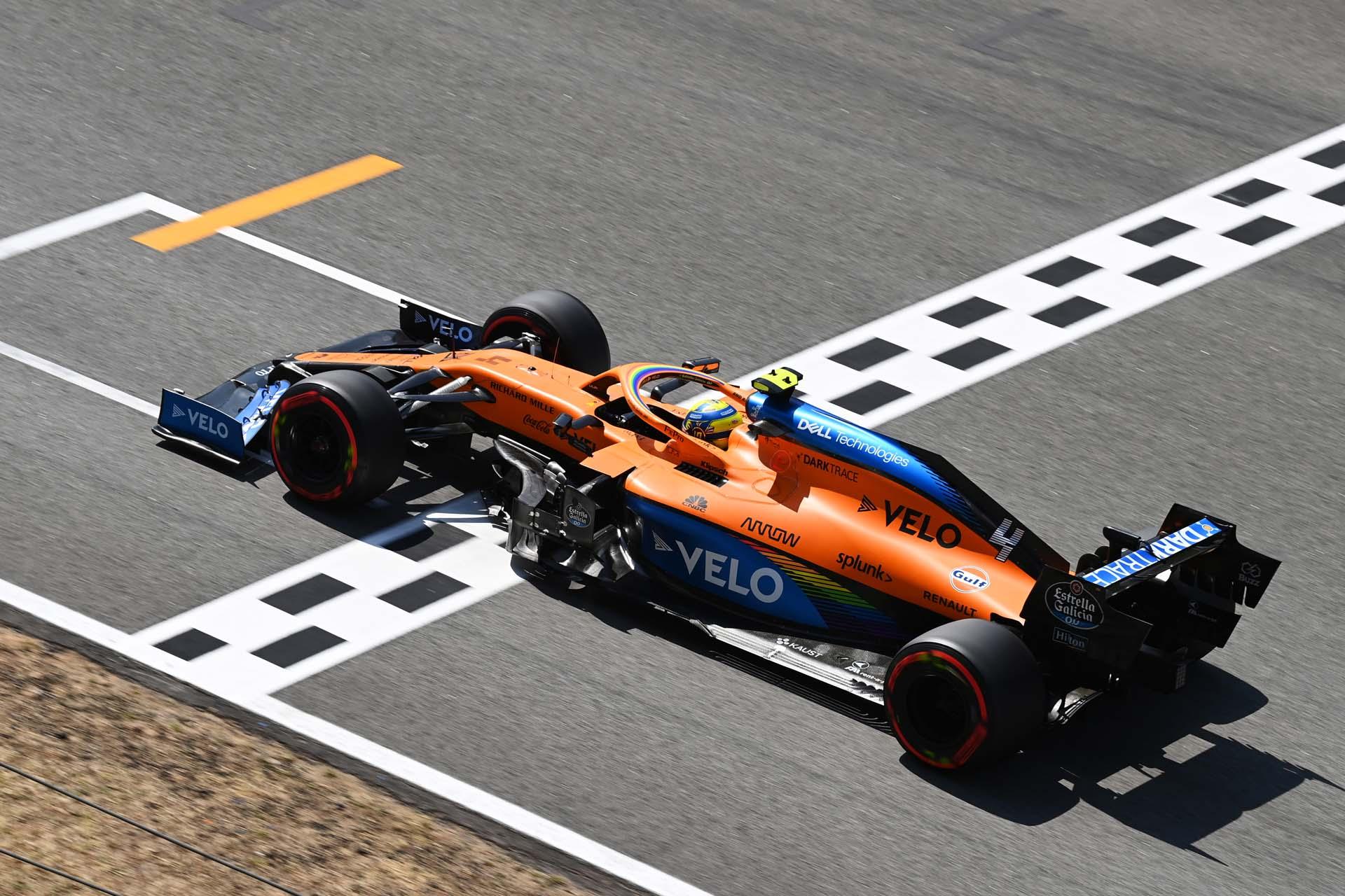 Lando Norris, McLaren MCL35, crosses the pit straight