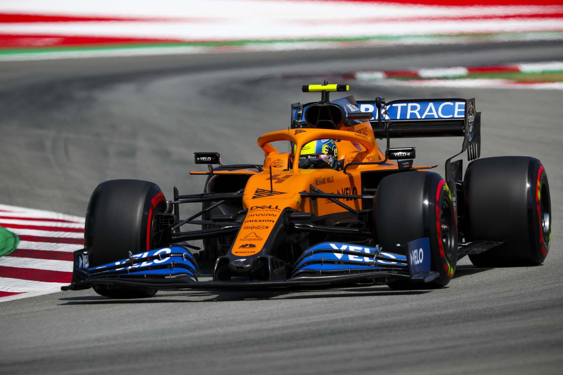 Lando Norris, McLaren MCL35, enters a corner