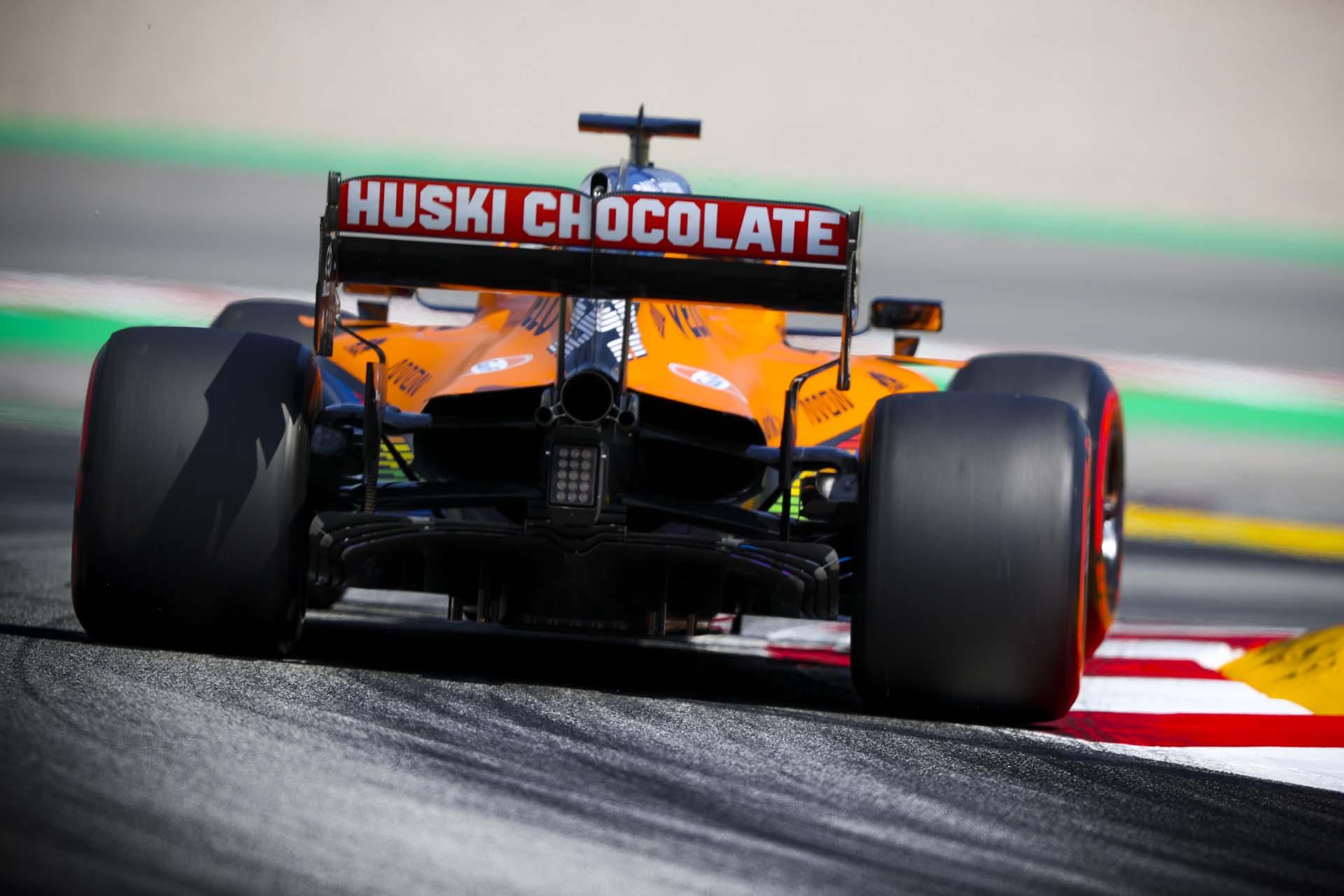 Carlos Sainz, McLaren MCL35, rides a kerb entering a chicane