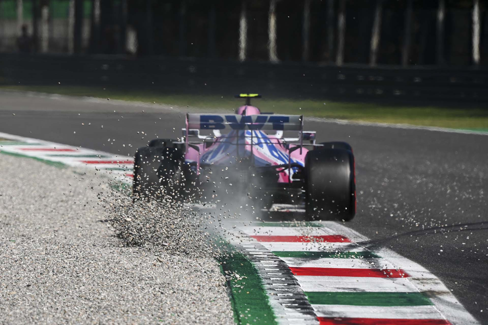 Gravel kicks up behind Lance Stroll, Racing Point RP20