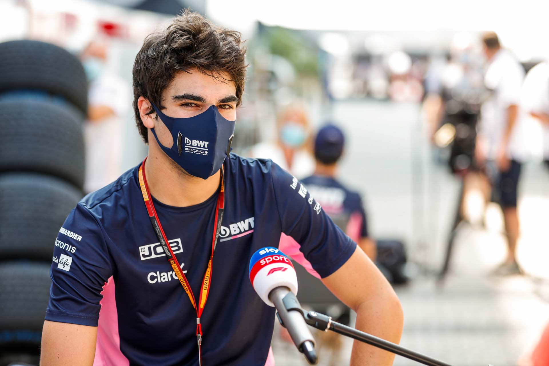 Lance Stroll, Racing Point, talks to the press
