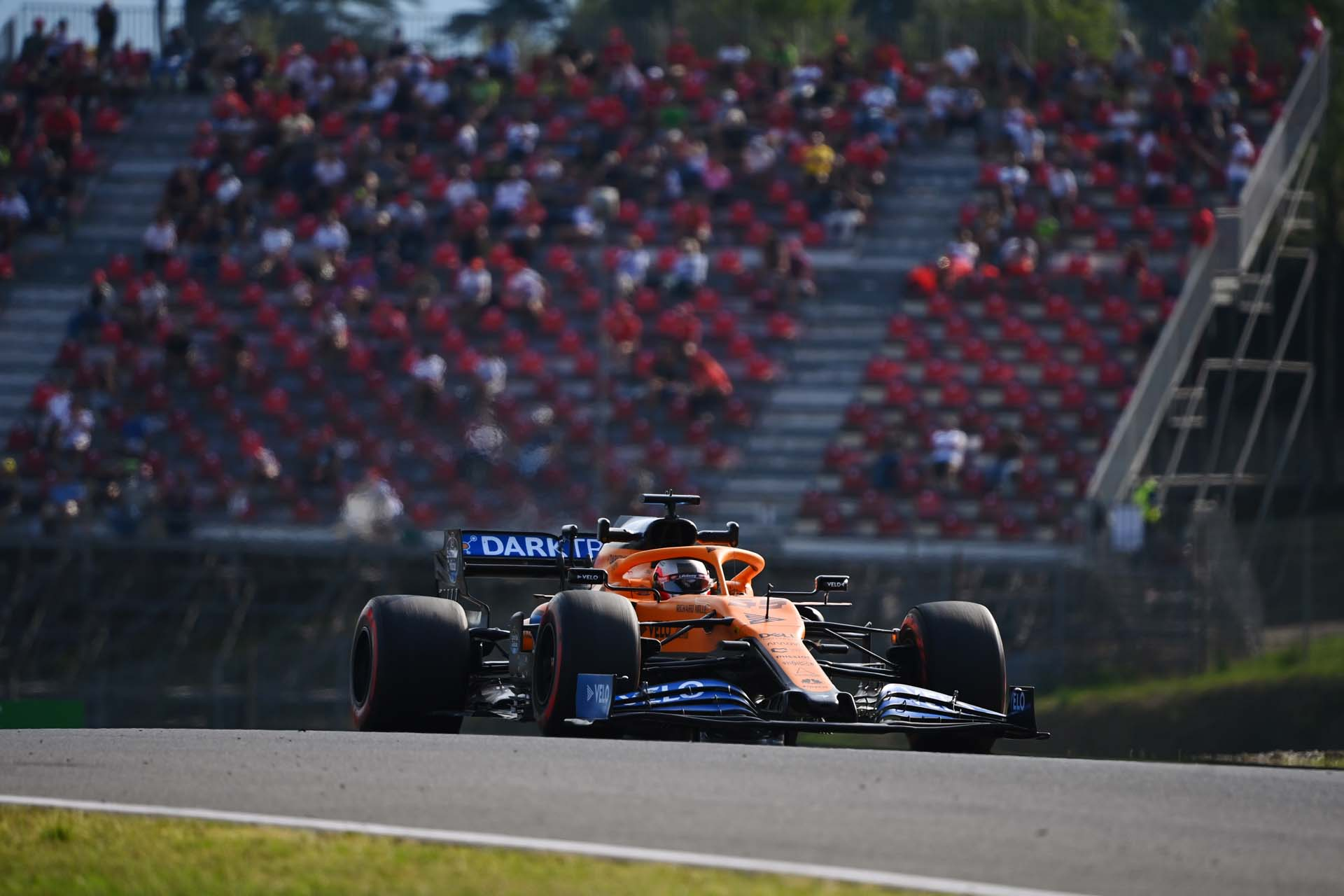 Carlos Sainz, McLaren MCL35, crests a brow on a straight