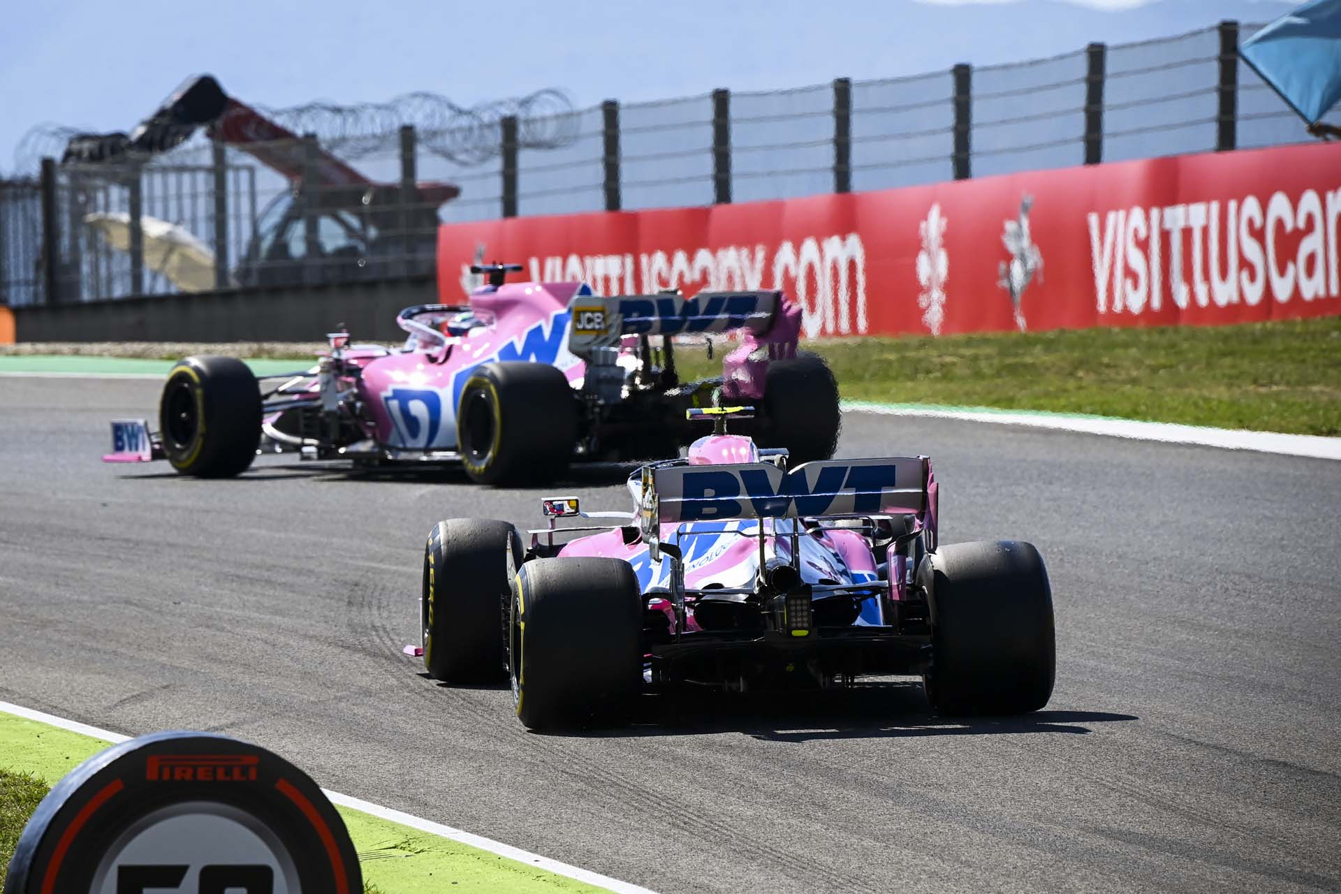 Sergio Perez, Racing Point RP20, leads Lance Stroll, Racing Point RP20