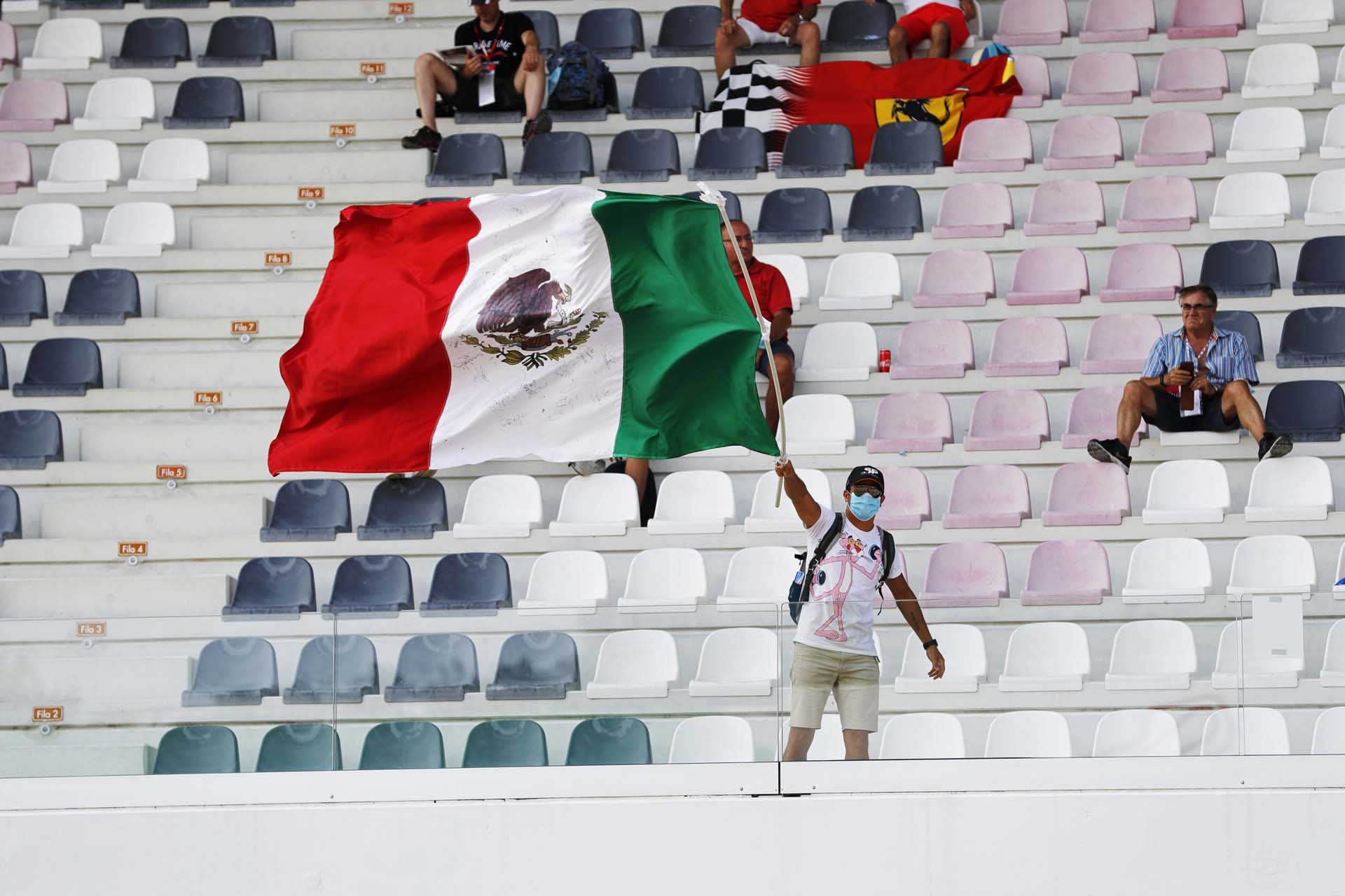 A Perez fan waves the Mexican flag in a grandstand