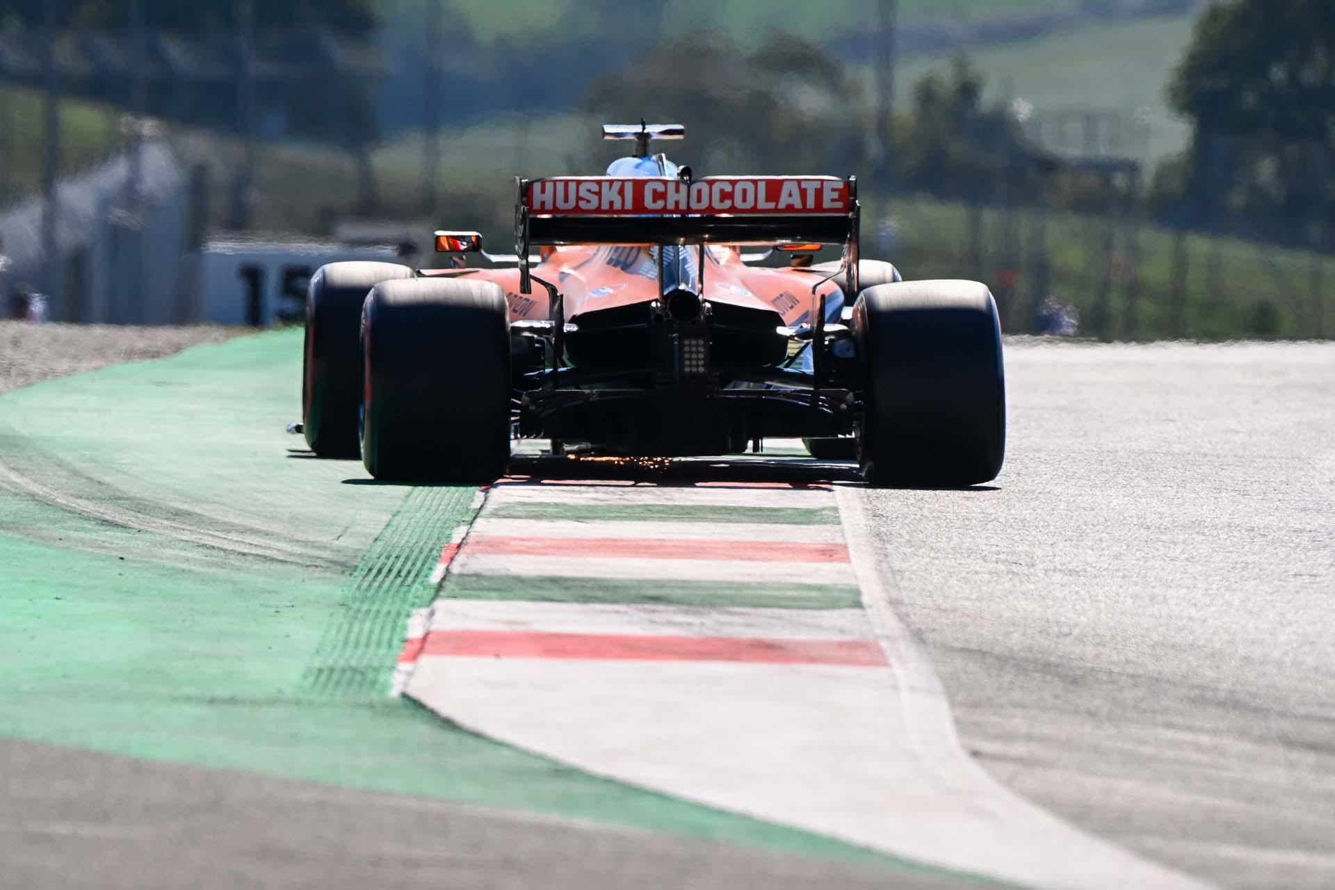 Carlos Sainz, McLaren MCL35, runs over a kerb exiting a corner