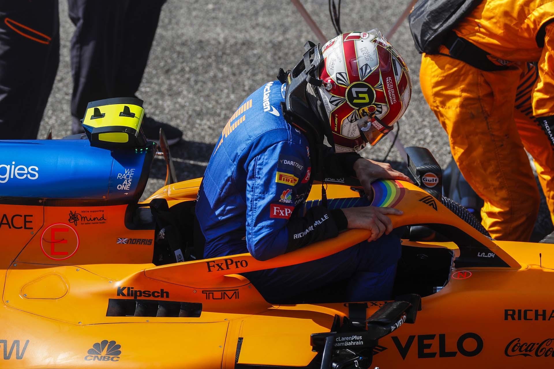 Lando Norris, McLaren, exits his cockpit on the grid