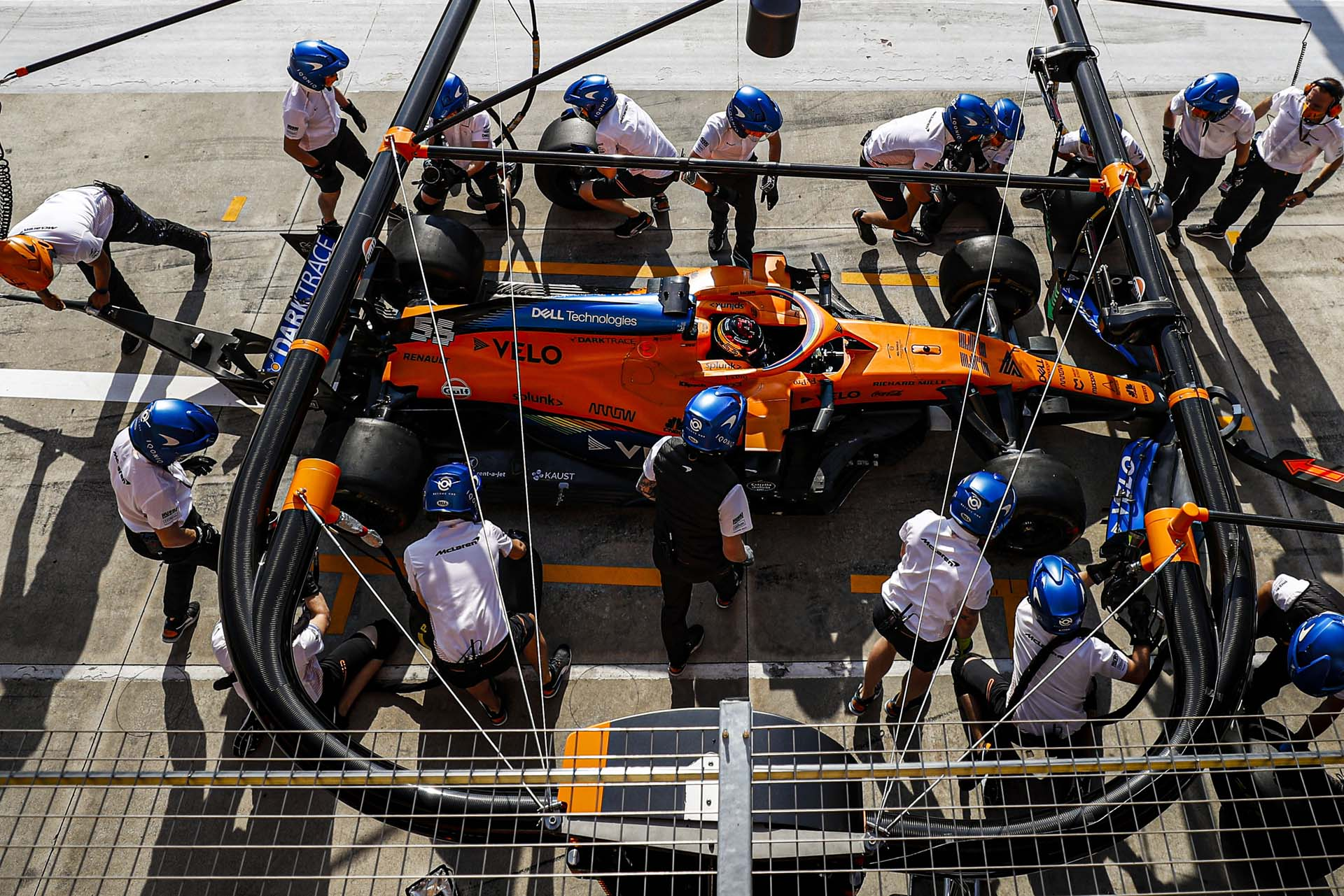 Carlos Sainz, McLaren MCL35, in the pits during practice