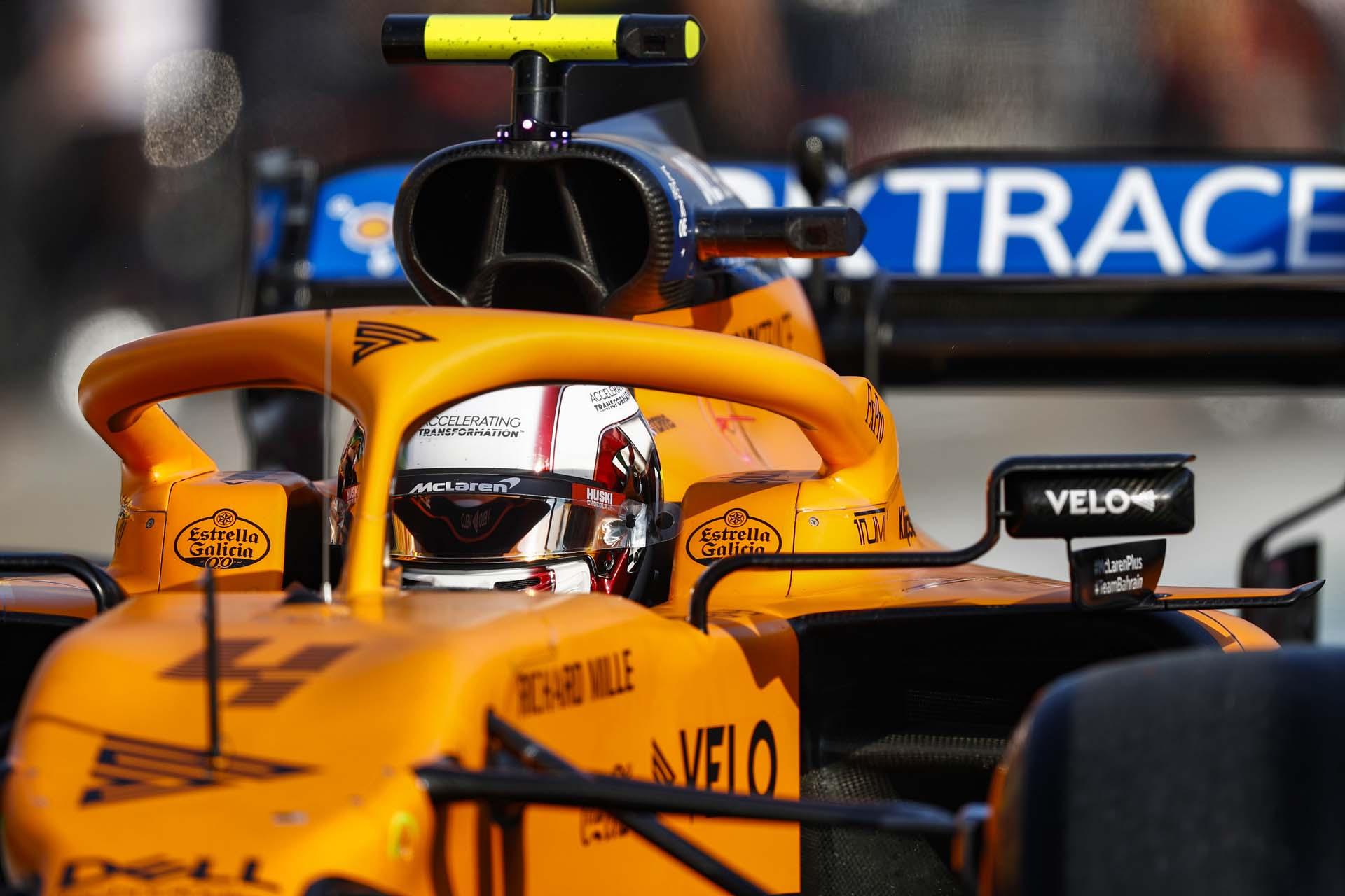 Lando Norris, McLaren MCL35, enters the pit lane
