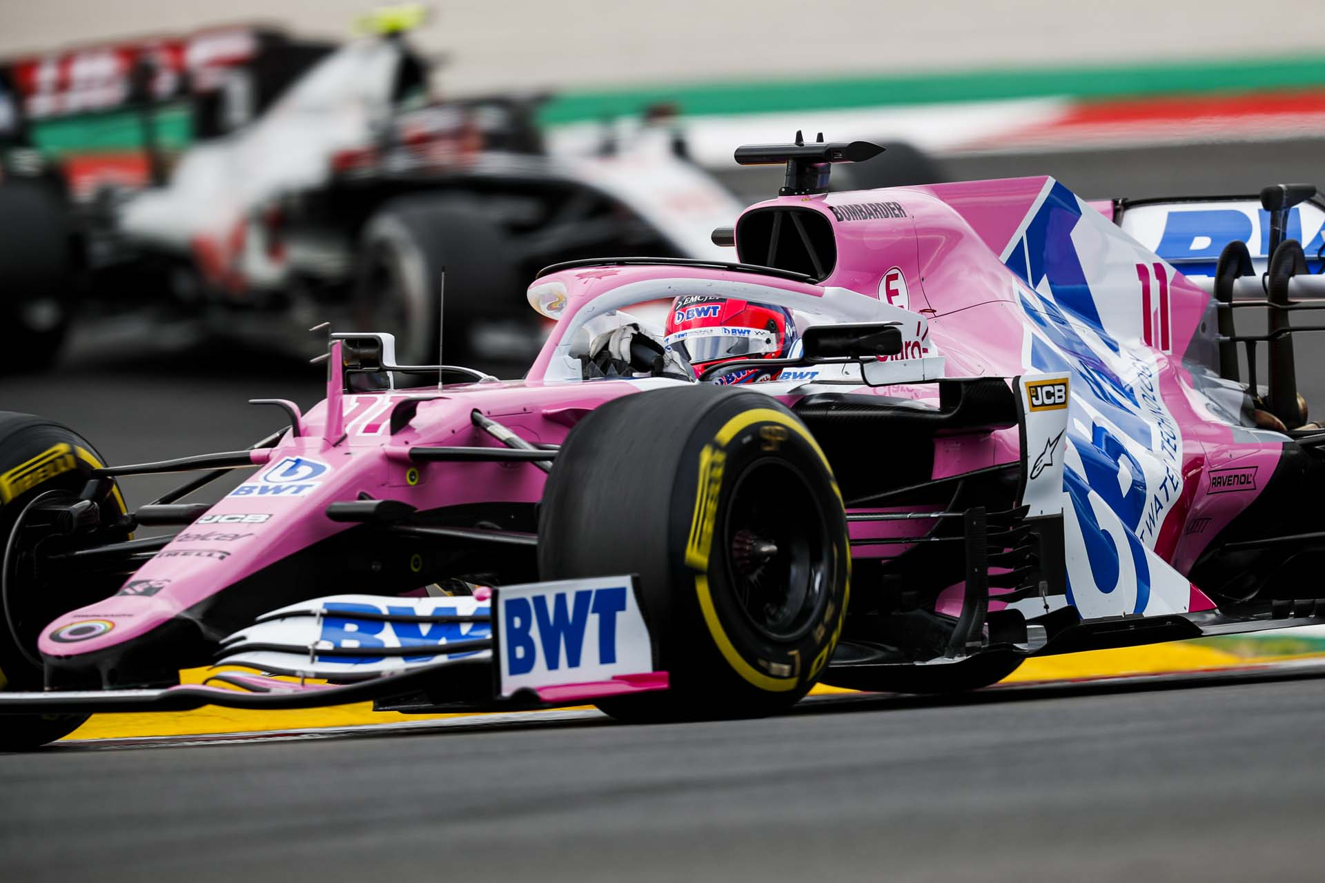 Sergio Perez, Racing Point RP20, leads Kevin Magnussen, Haas VF-20