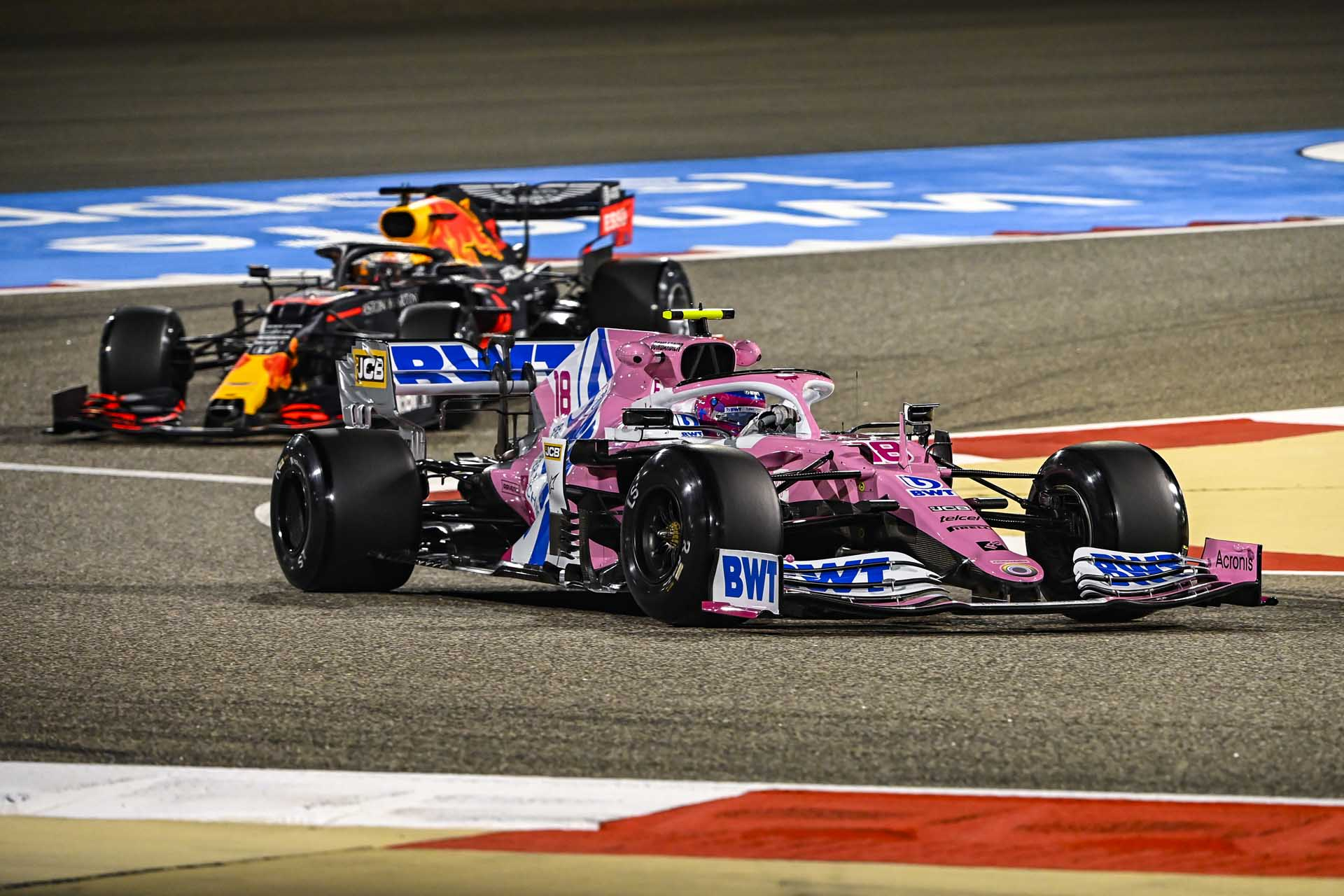 Lance Stroll, Racing Point RP20, leads Max Verstappen, Red Bull Racing RB16