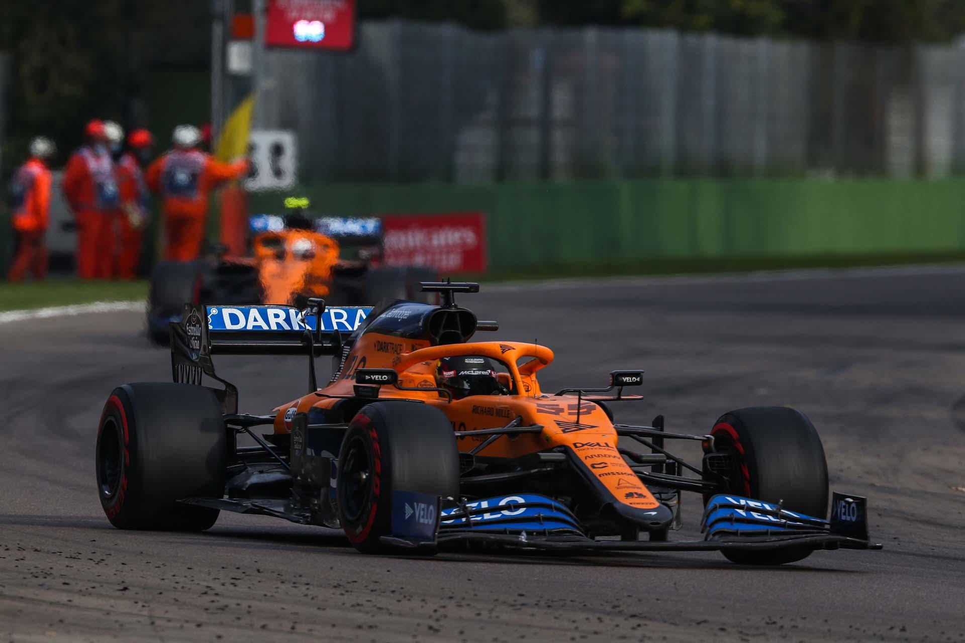 Carlos Sainz, McLaren MCL35, passes a marshals' post