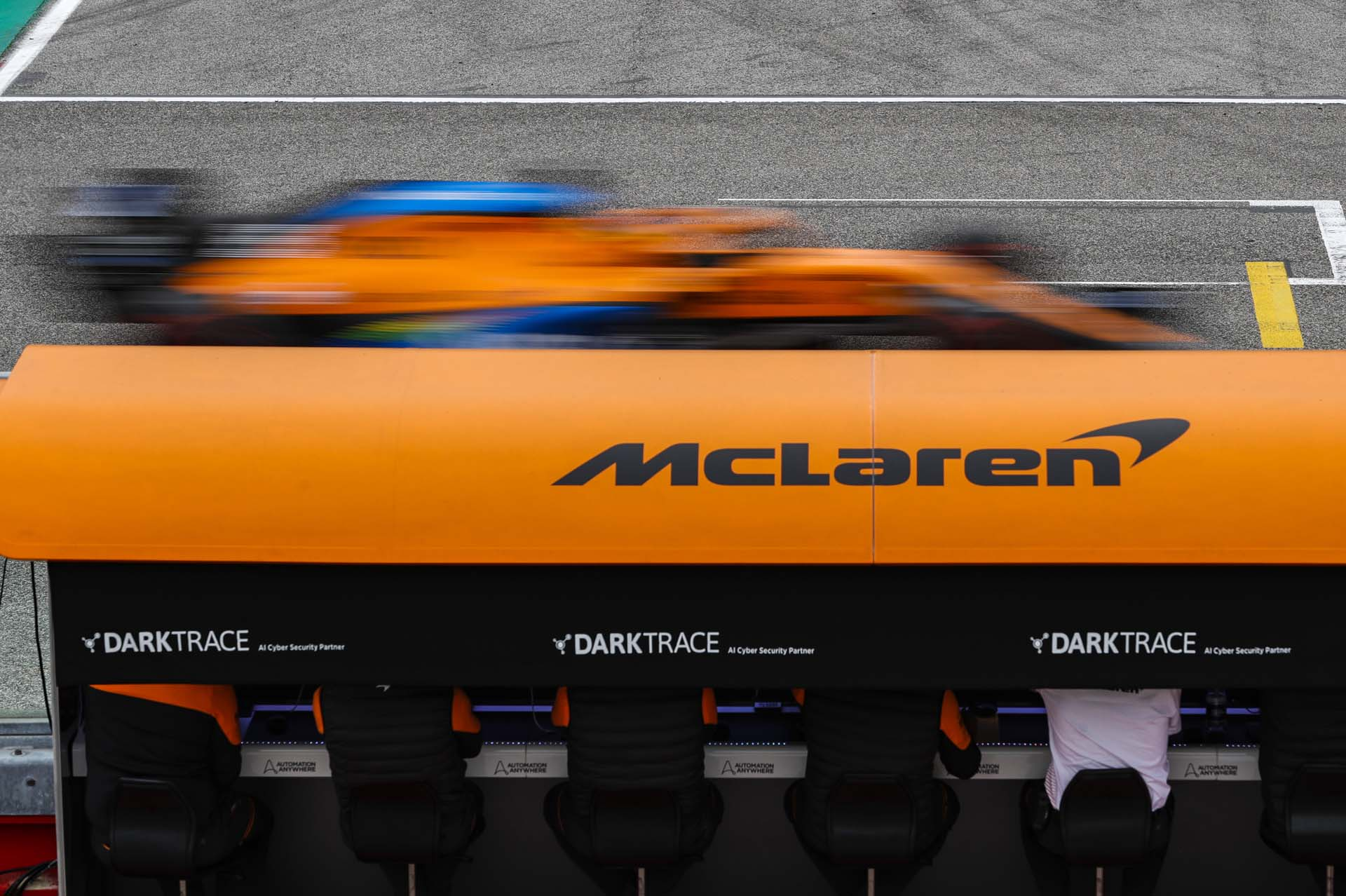 Carlos Sainz, McLaren MCL35, passes the McLaren pit wall