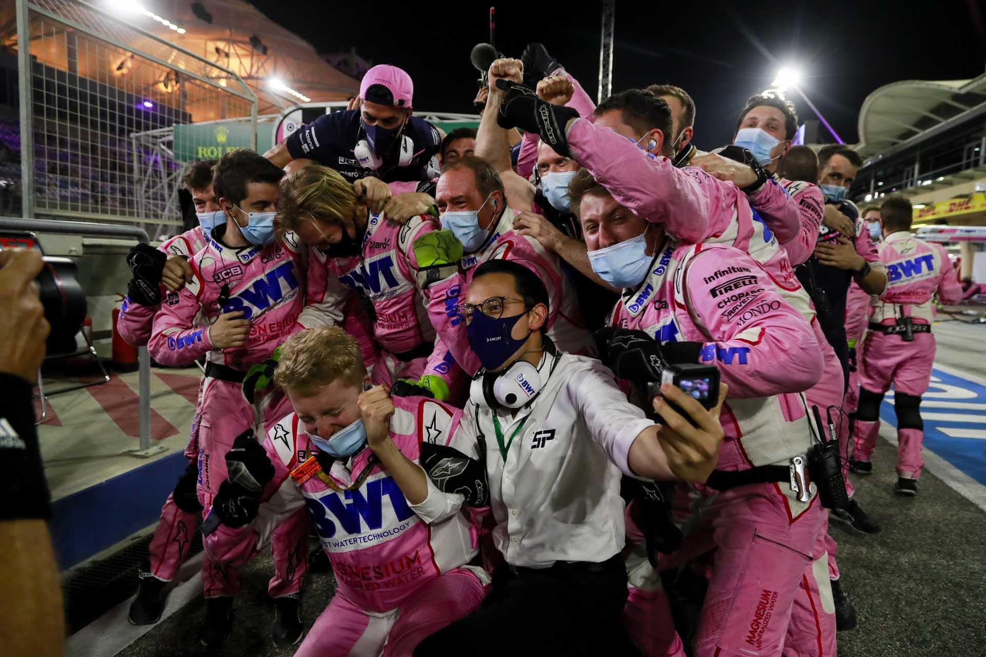 Racing point Team members celebrating in parc ferme