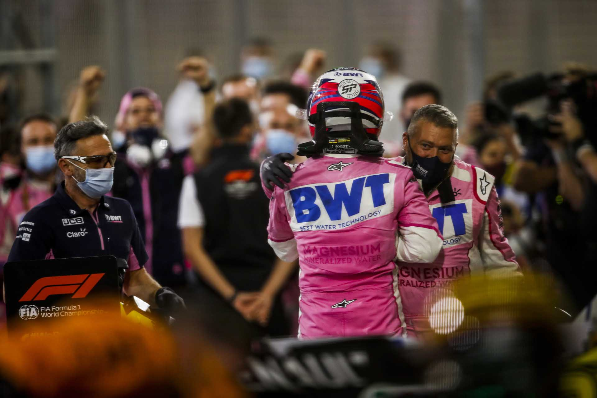 Race Winner Sergio Perez, Racing Point celebrates in parc ferme with his team