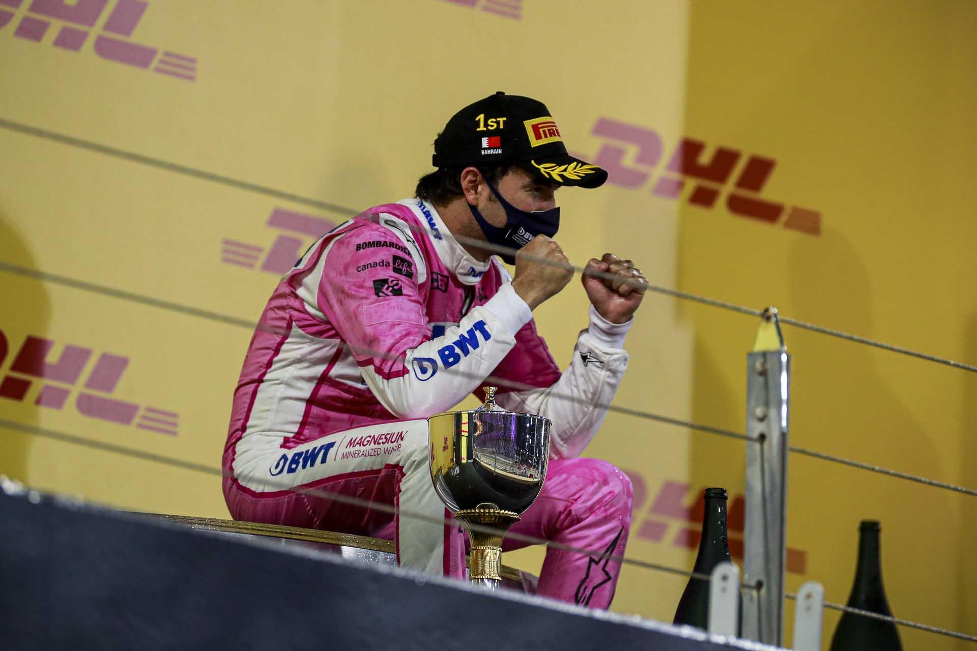 Race Winner Sergio Perez, Racing Point celebrates on the podium