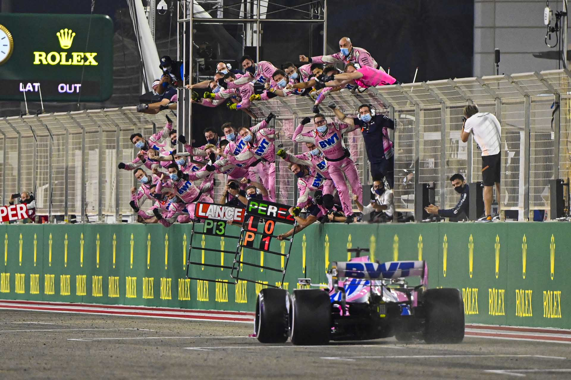 Sergio Perez, Racing Point RP20, crosses the finish line to take the race win